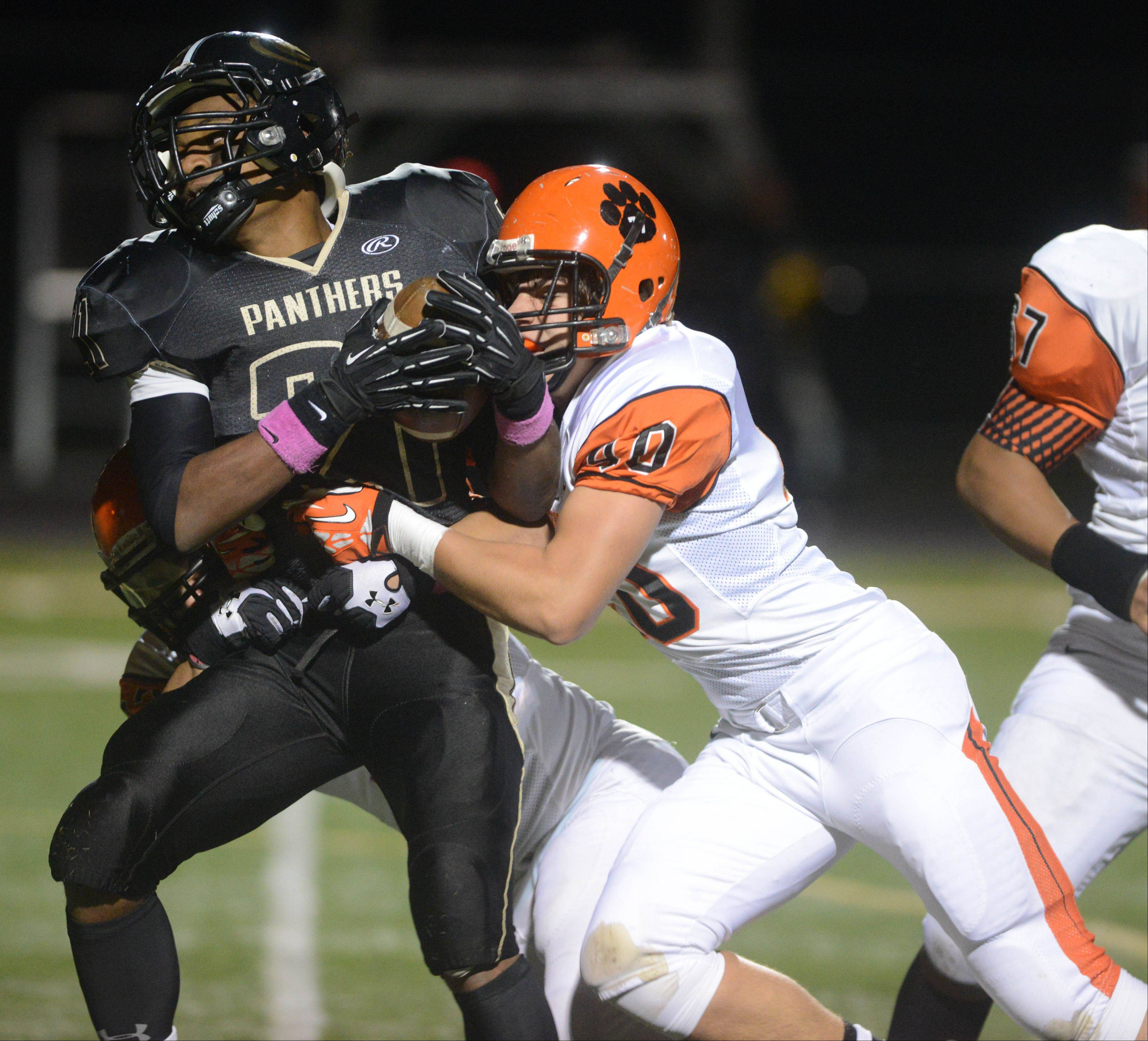 Justin Jackson of Glenbard North is pulled down by Tommy Vitale of Wheaton Warrenville South.