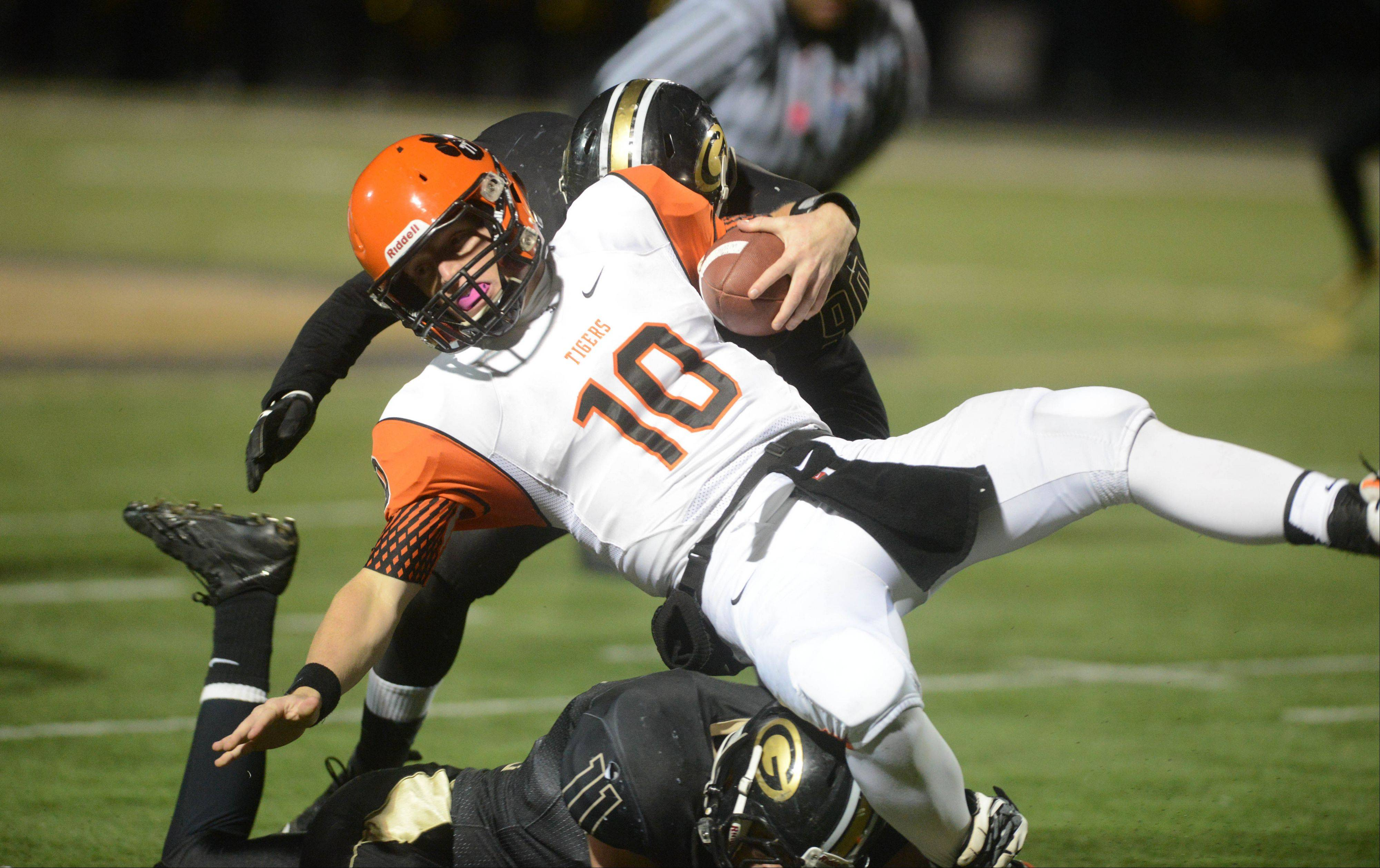 Ryan Graham of Wheaton Warrenville south is pulled down .