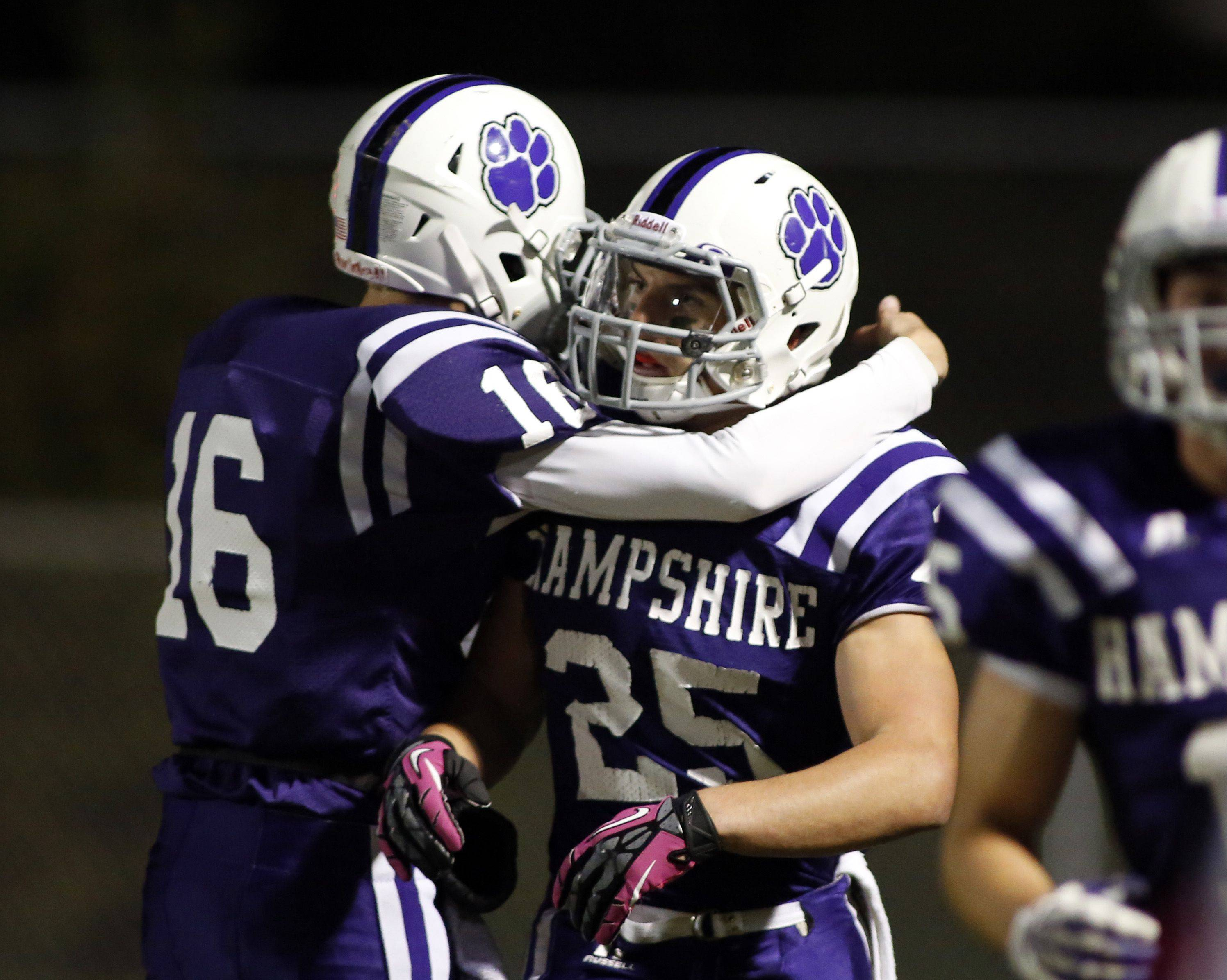 Hampshire's Nick Mohlman, left, greets teammate Nick Kielbasa after a touchdown Friday night during the Whip-Purs' win over Johnsburg.