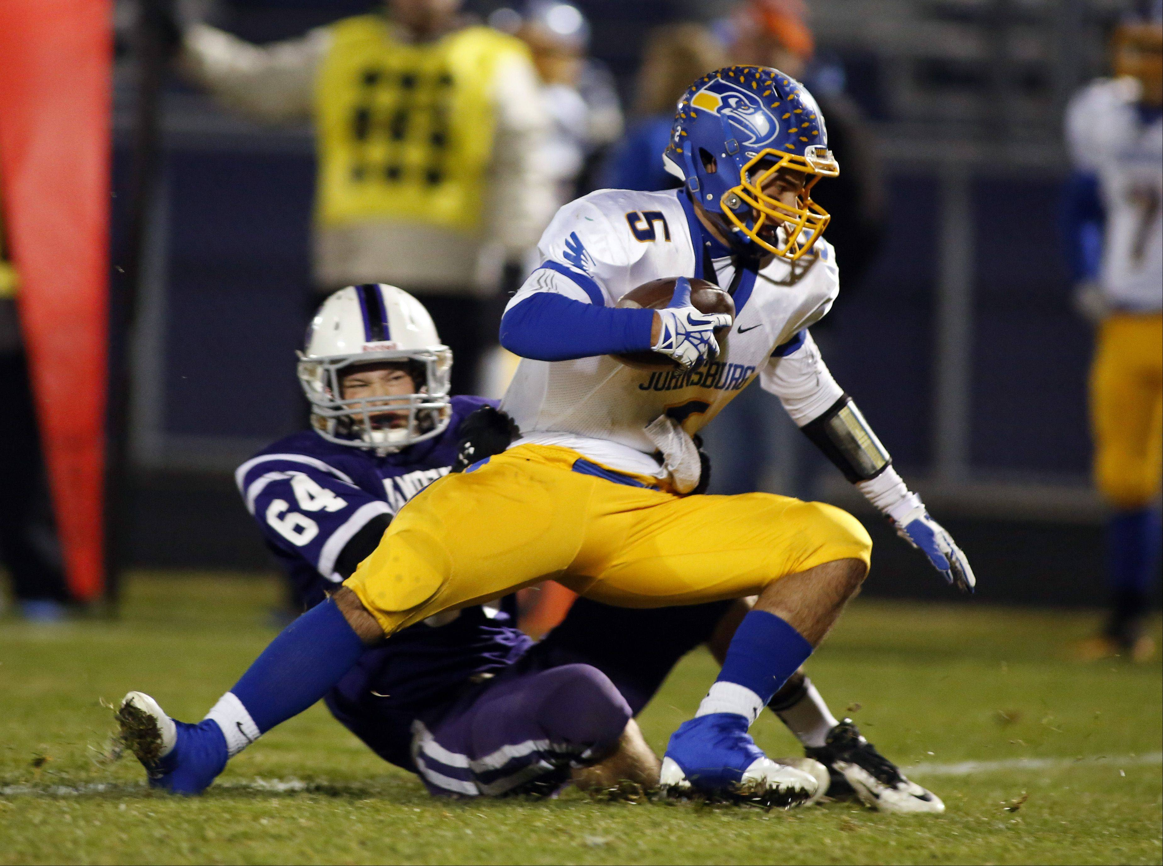 Hampshire's Stephen Kirkwood pulls down Johnsburg's Nick Brengman for a loss Friday night in Hampshire.