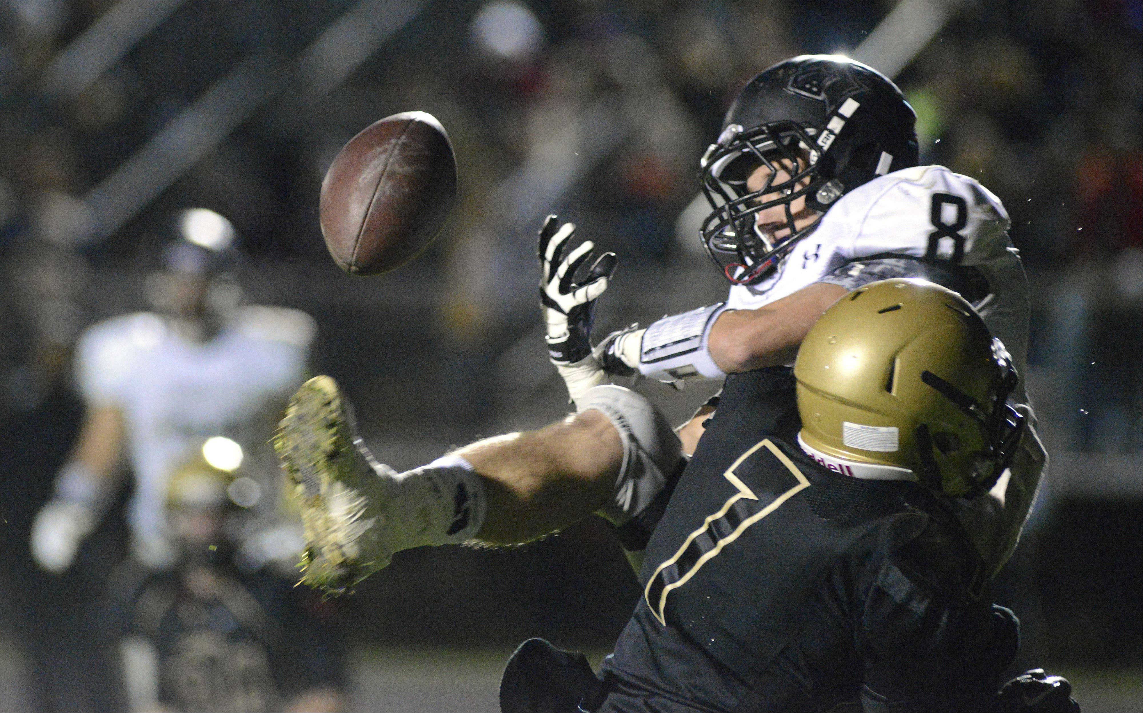 A pass is incomplete to Kaneland's Brandon Bishop in the end zone as he gets hit by Sycamore's Michael Stinnett in the second quarter.