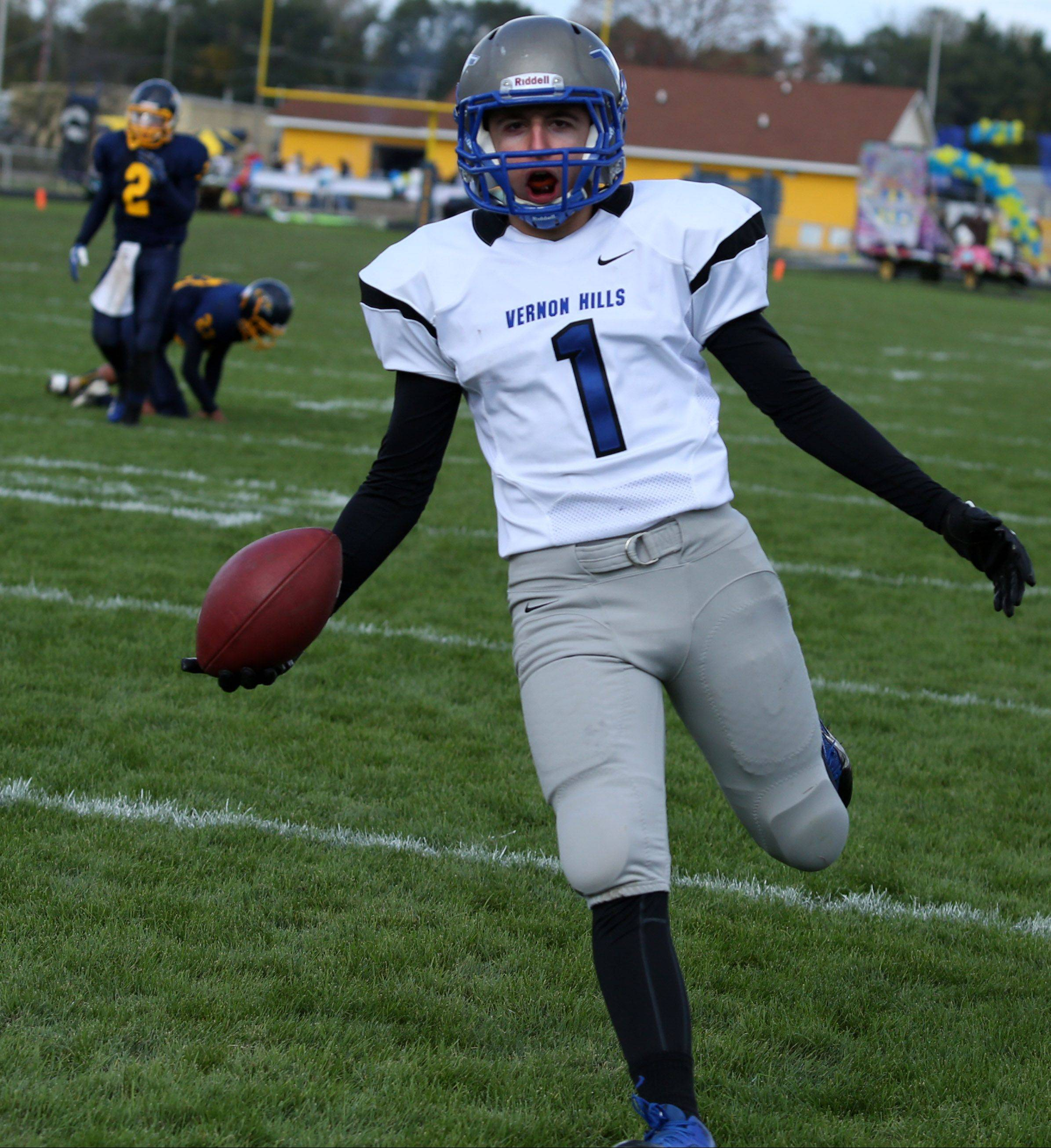 Vernon Hills receiver Robby Nardini celebrates as he crosses the goal line against host Round Lake on Saturday.