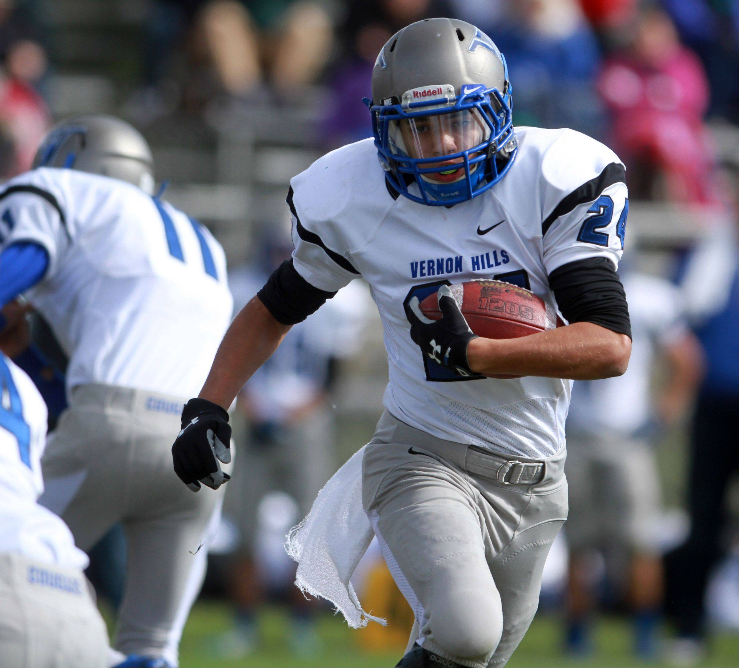 Vernon Hills running back Andres Salazar gets upfield against host Round Lake on Saturday.