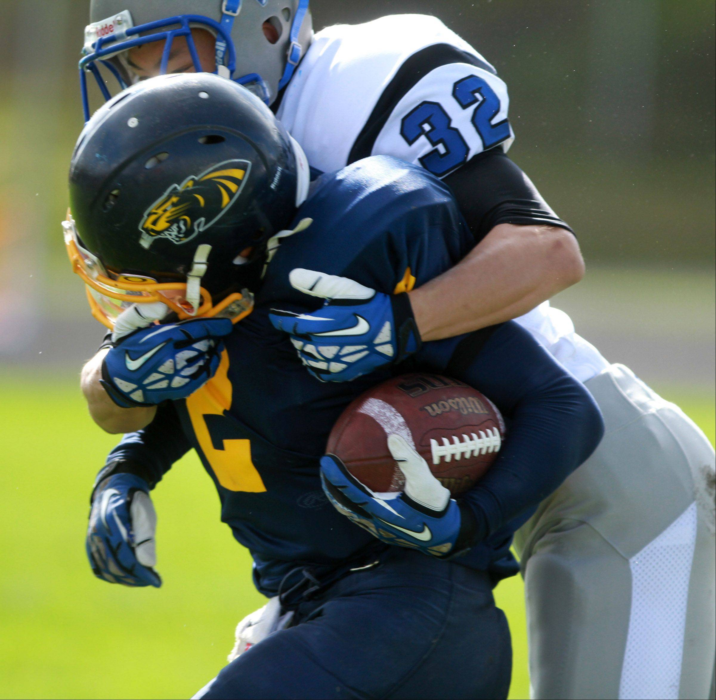 Vernon Hills defender Ben Campbell wraps up Round Lake's Karnell Wright at Round Lake on Saturday.