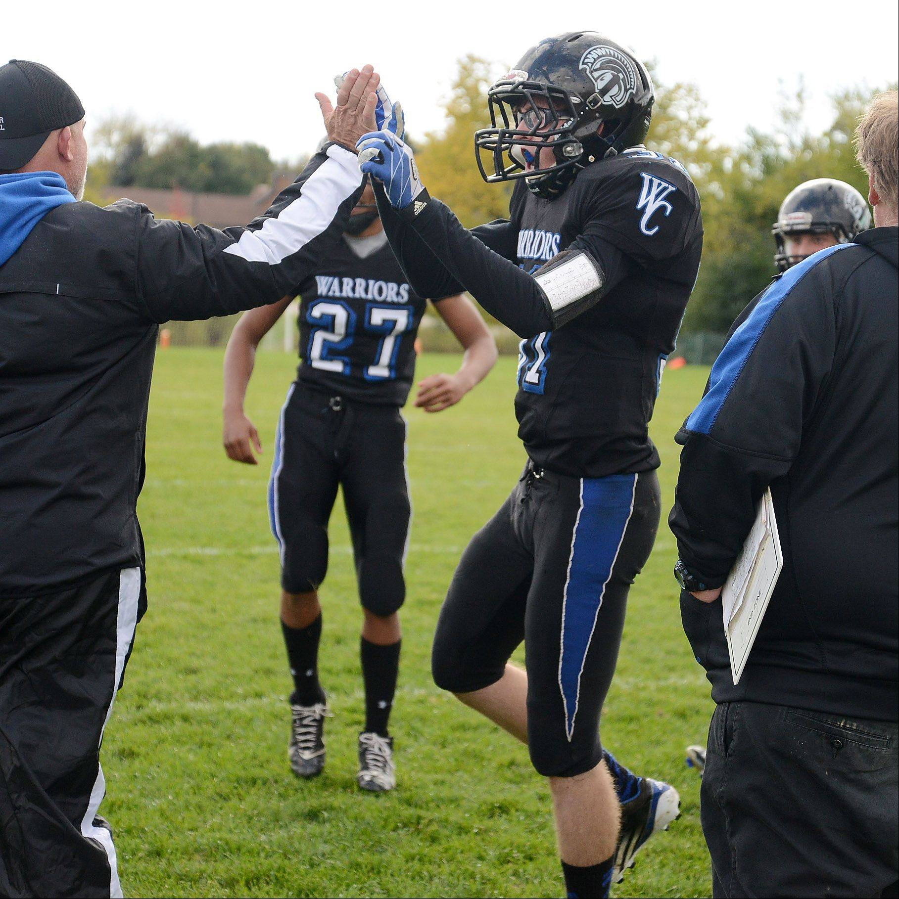 Drew Dahlman of Westminster Christian celebrates along the sidelines after a successful onside kick against Christian Liberty Saturday.