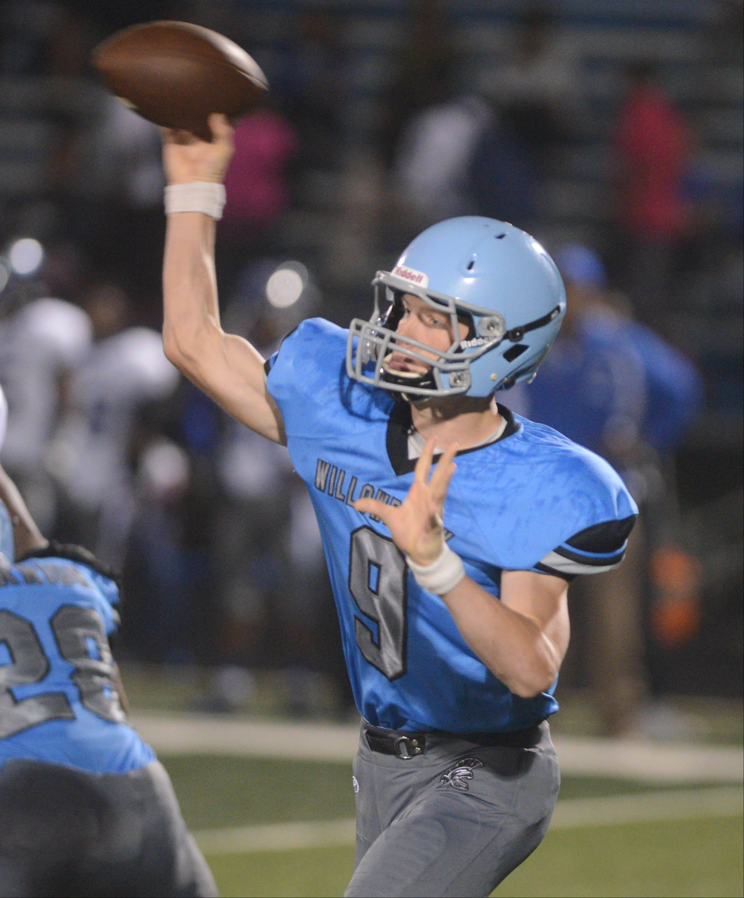 Willowbrook quarterback Brian Johnson (#9) fires one during the Proviso East at Willowbrook football game Friday in Villa Park