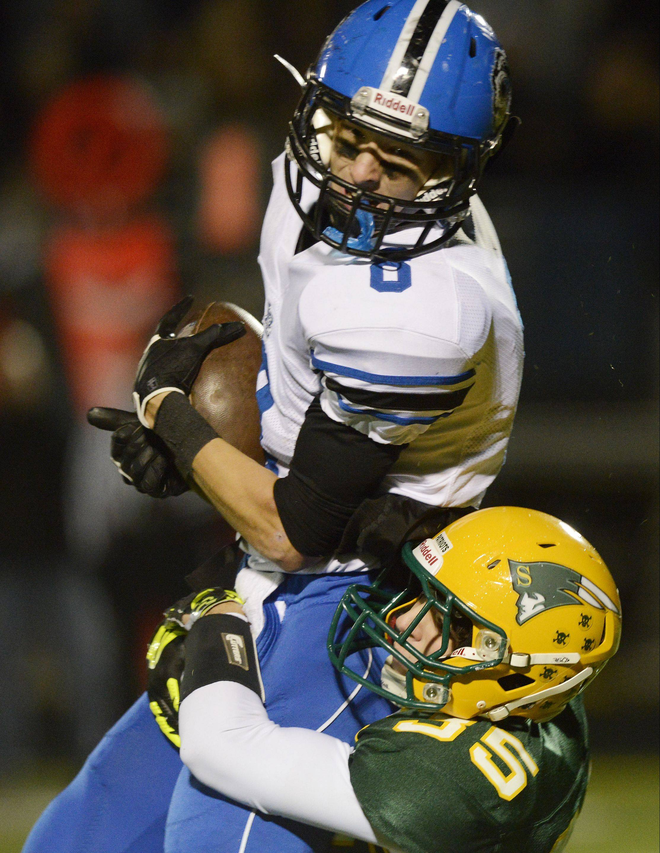 Lake Zurich's Brent Sweetwood is tackled by Stevenson's Sam Oriatti after making a catch during Friday's NSC Lake showdown in Lincolnshire.