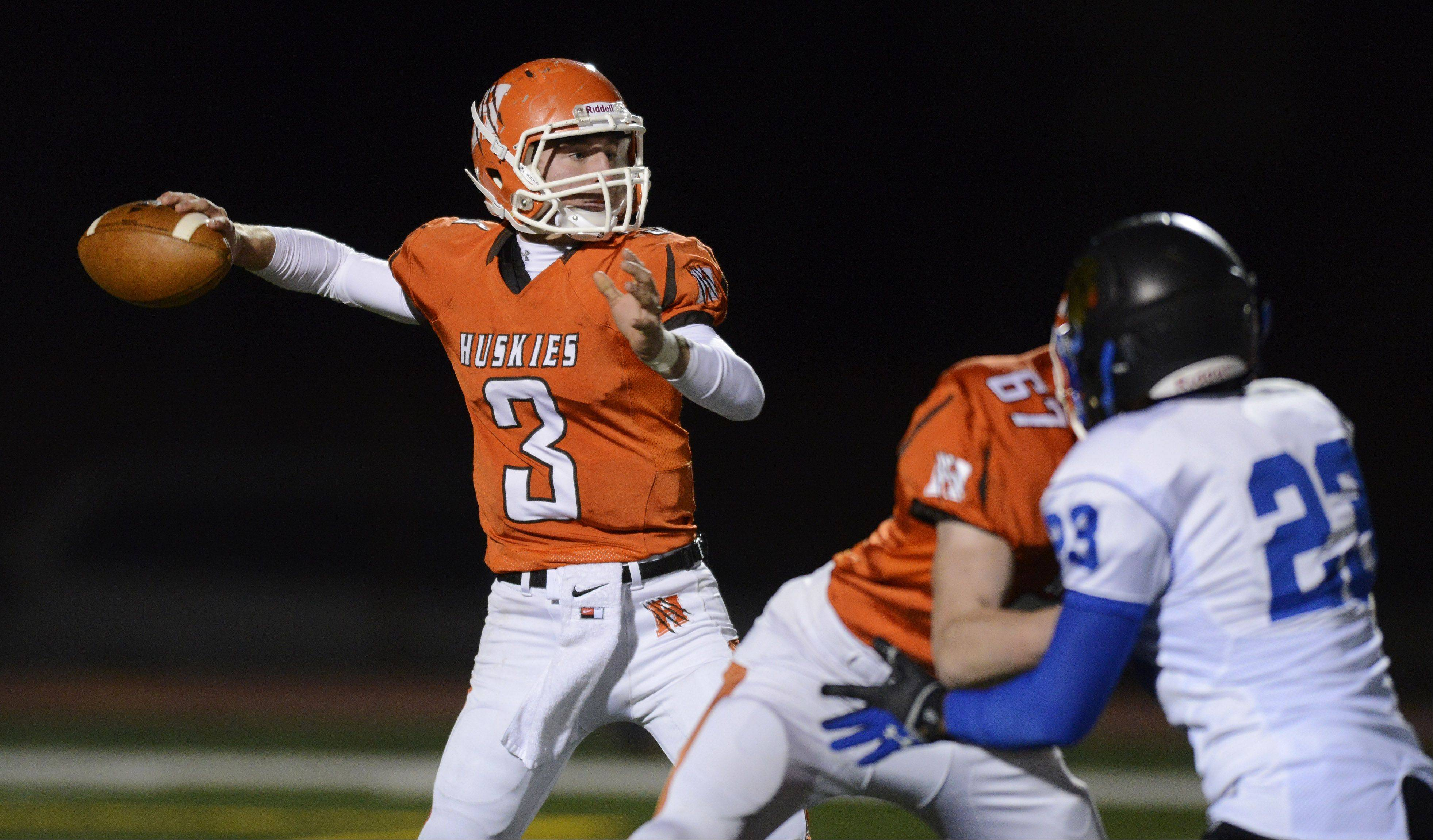 Hersey quarterback Jack Warner throws a pass as teammate Danny Somary blocks Wheeling's Allan Rodriguez on Friday.