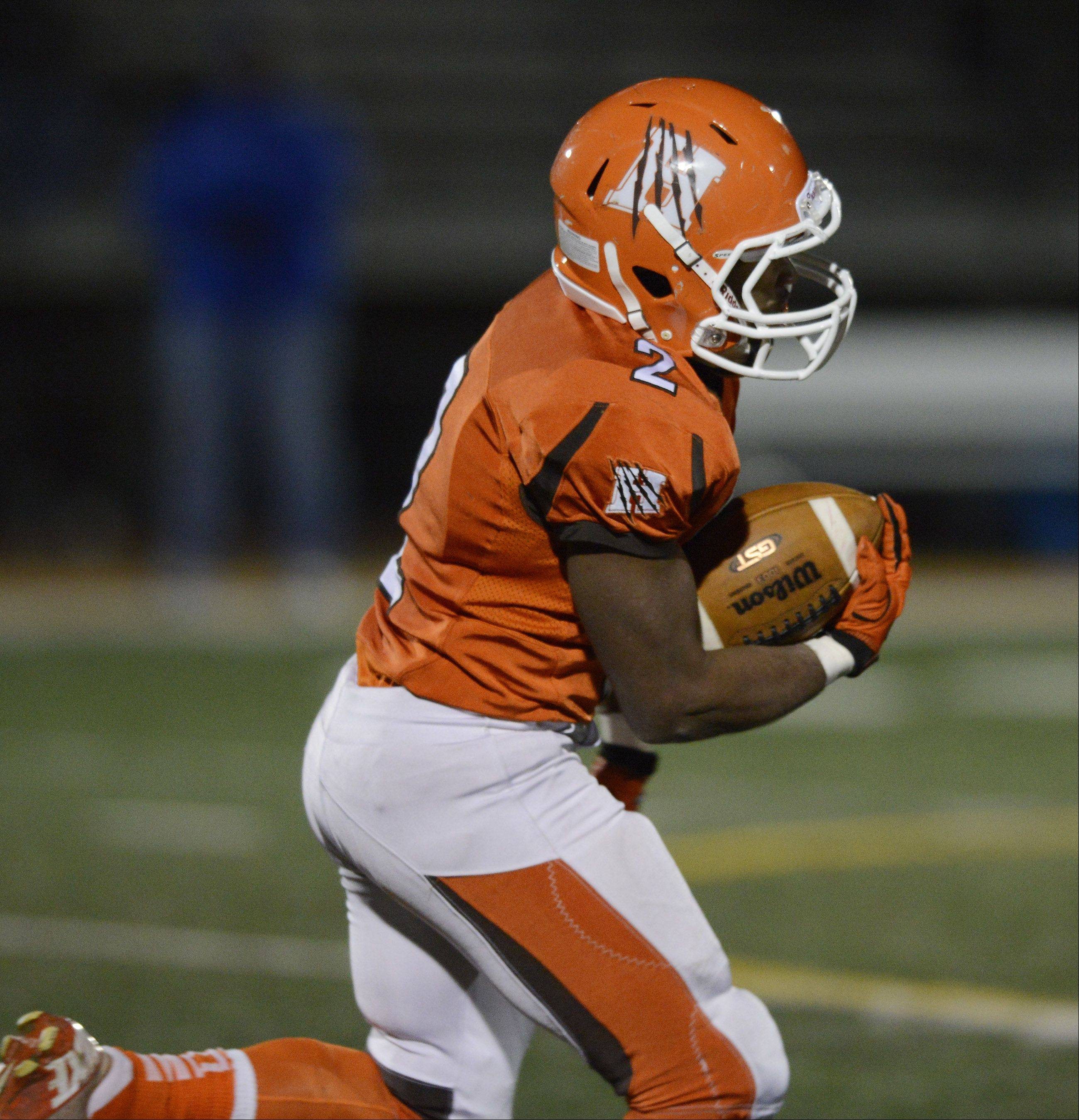 Hersey's Mario Thomas carries the ball for a touchdown on the first play from scrimmage to start the third quarter.