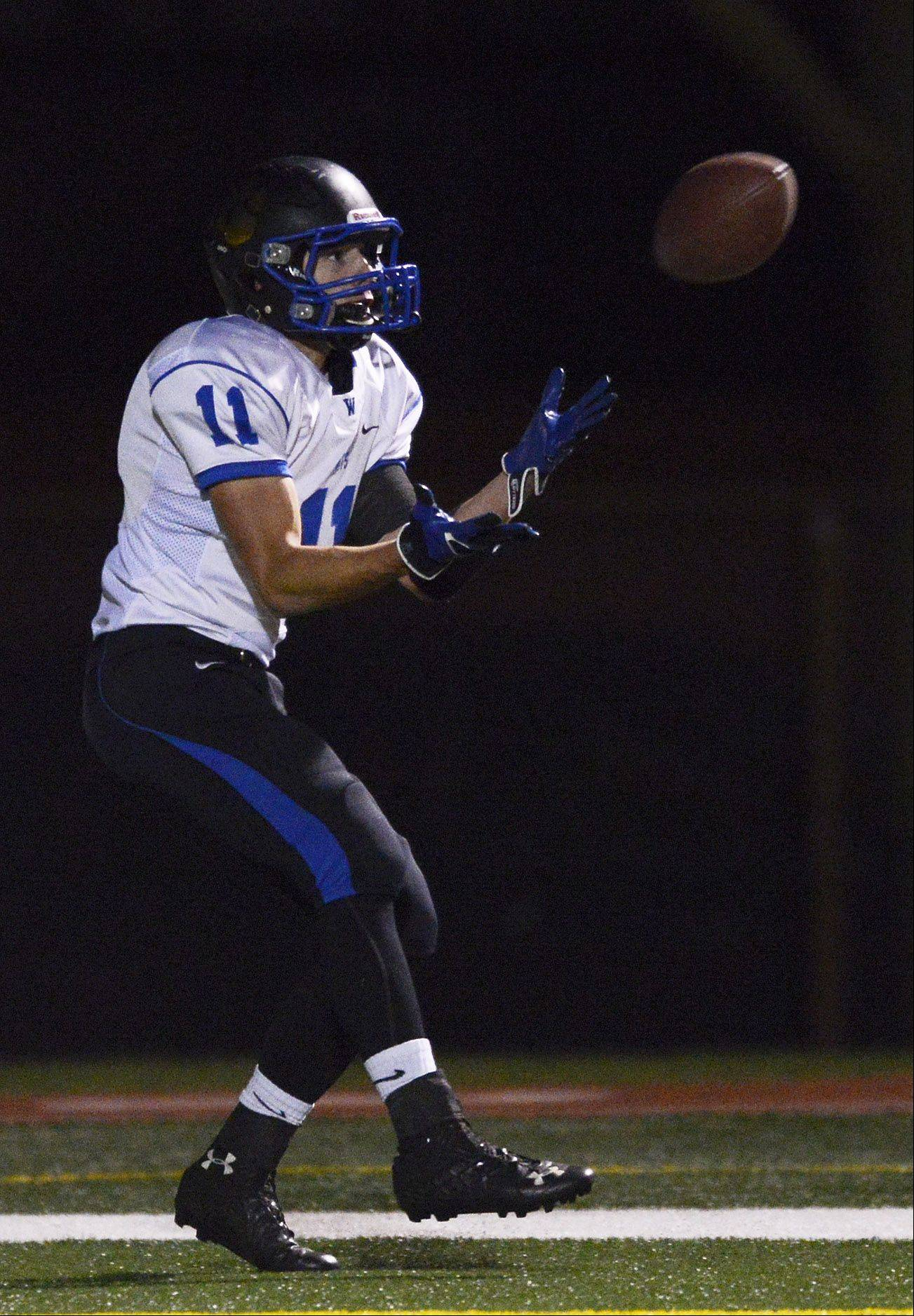 Wheeling's Tyler Urban catches a pass in the end zone for a touchdown .