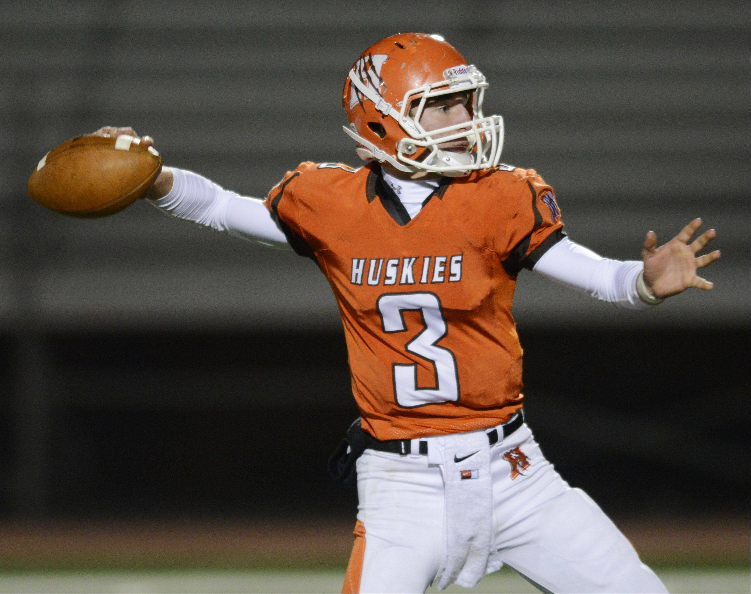 Hersey quarterback Jack Warner throws a pass for a two-point conversion during the third quarter.