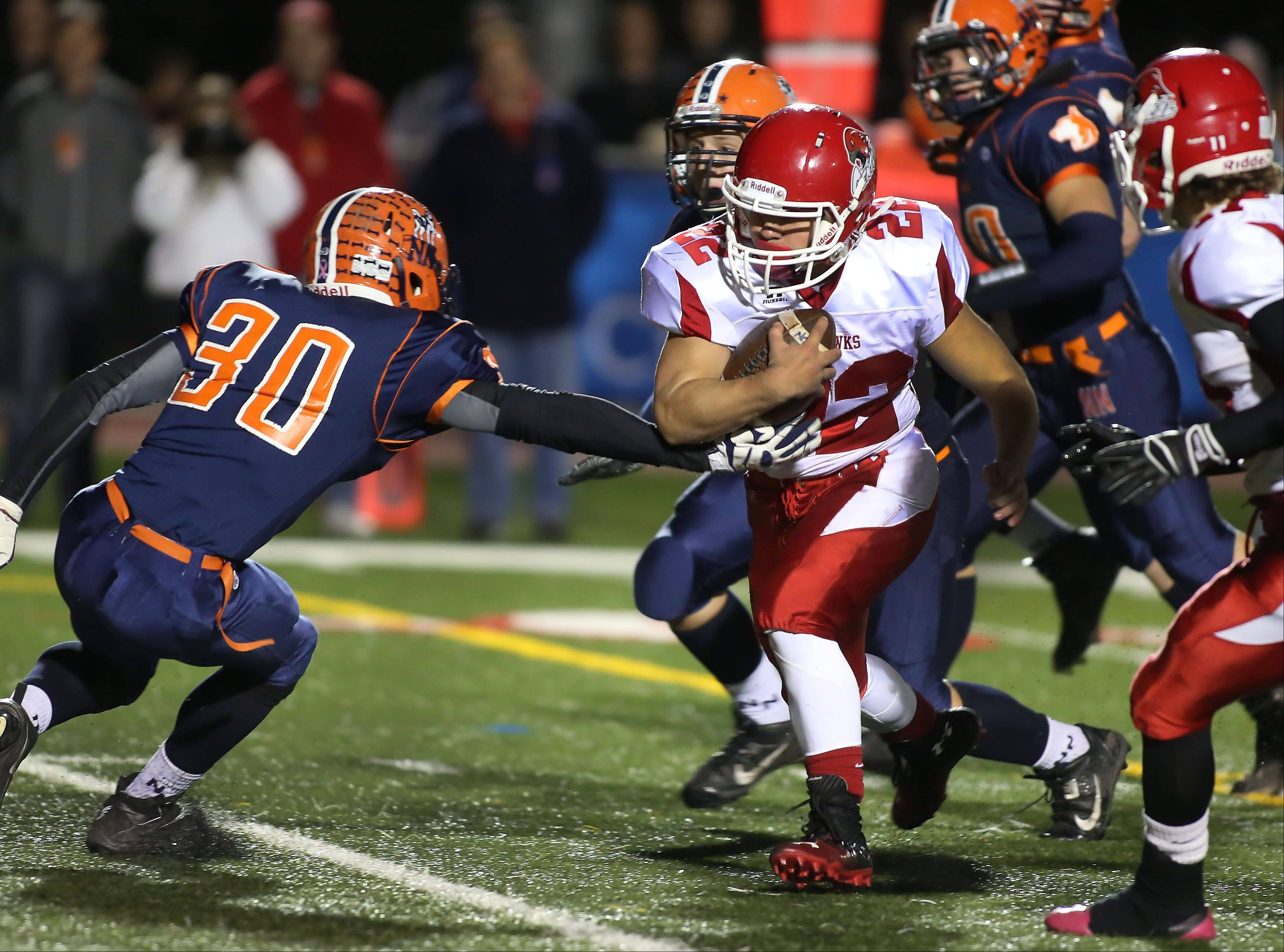 Adam Milsap, left, of Naperville North moves in to try and prevent Kevin Clifford of Naperville Central from making a touchdown in the second quarter.