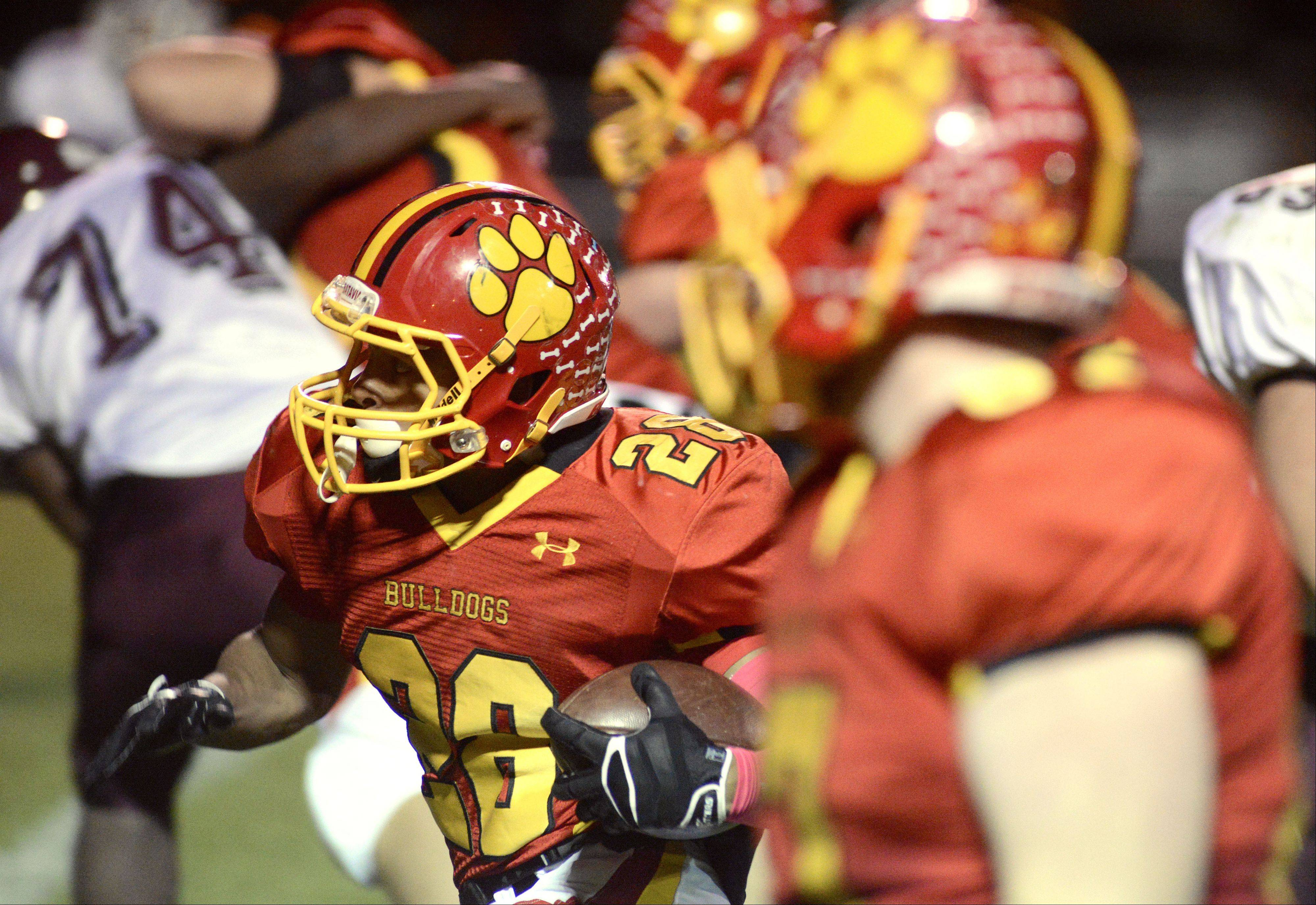 Batavia's Anthony Scaccia pops out of a hole in Elgin's defense on his way to a touchdown in the first quarter.