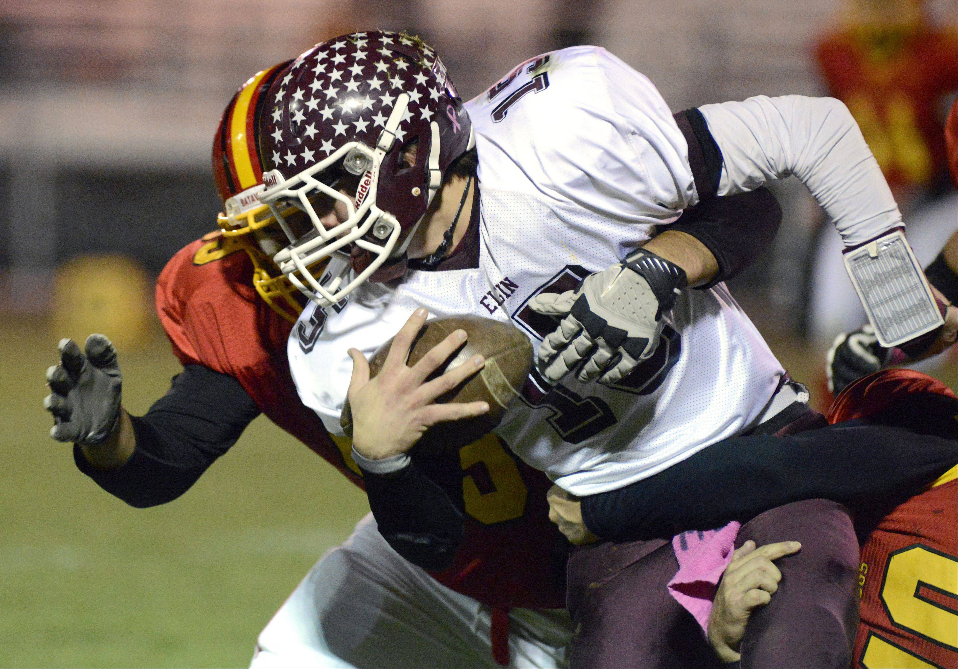 Batavia's Stefyn Cortez tackles Elgin's Ryan Sitter in the second quarter.