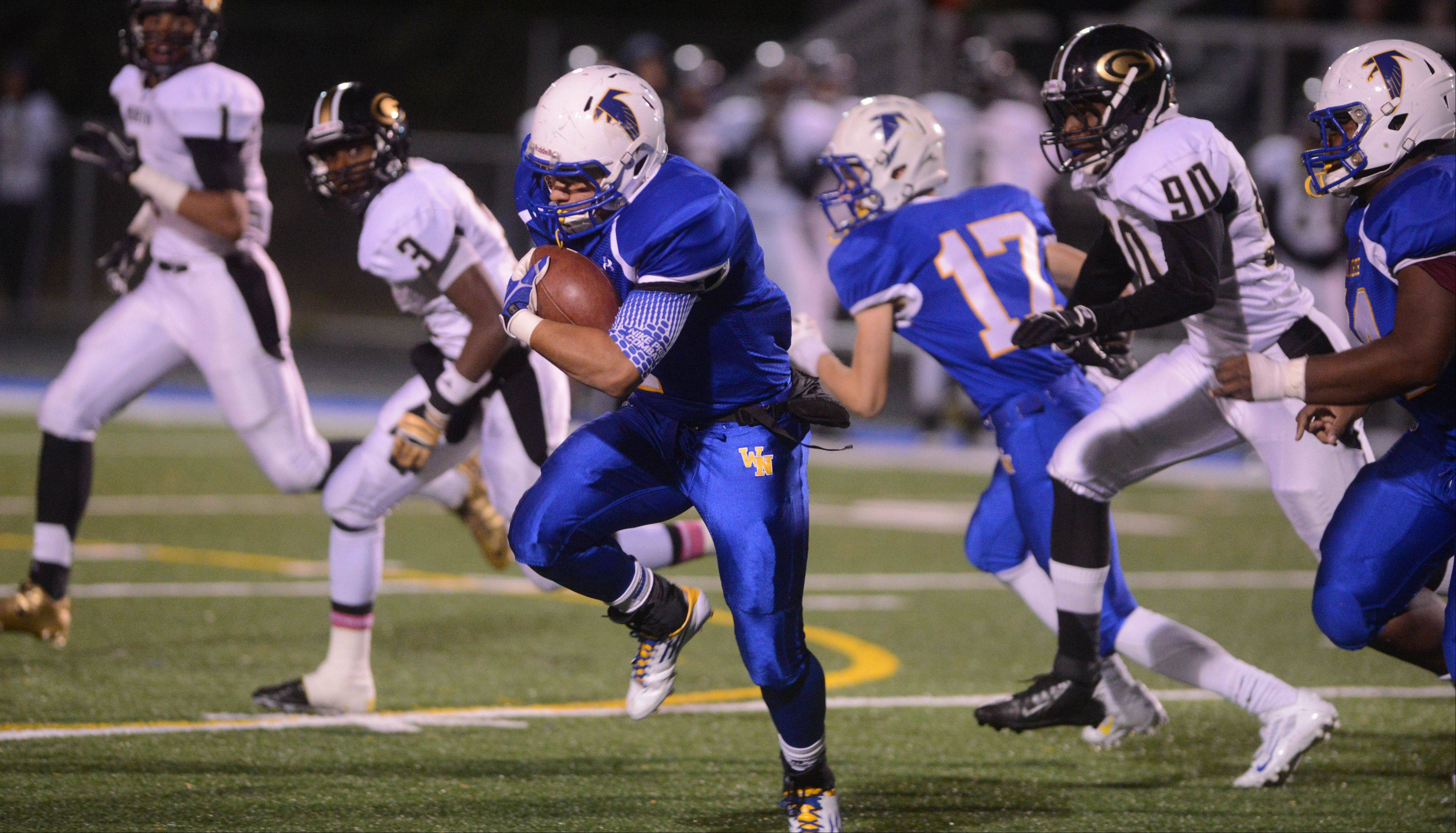 Dom Garza of Wheaton North runs the ball.