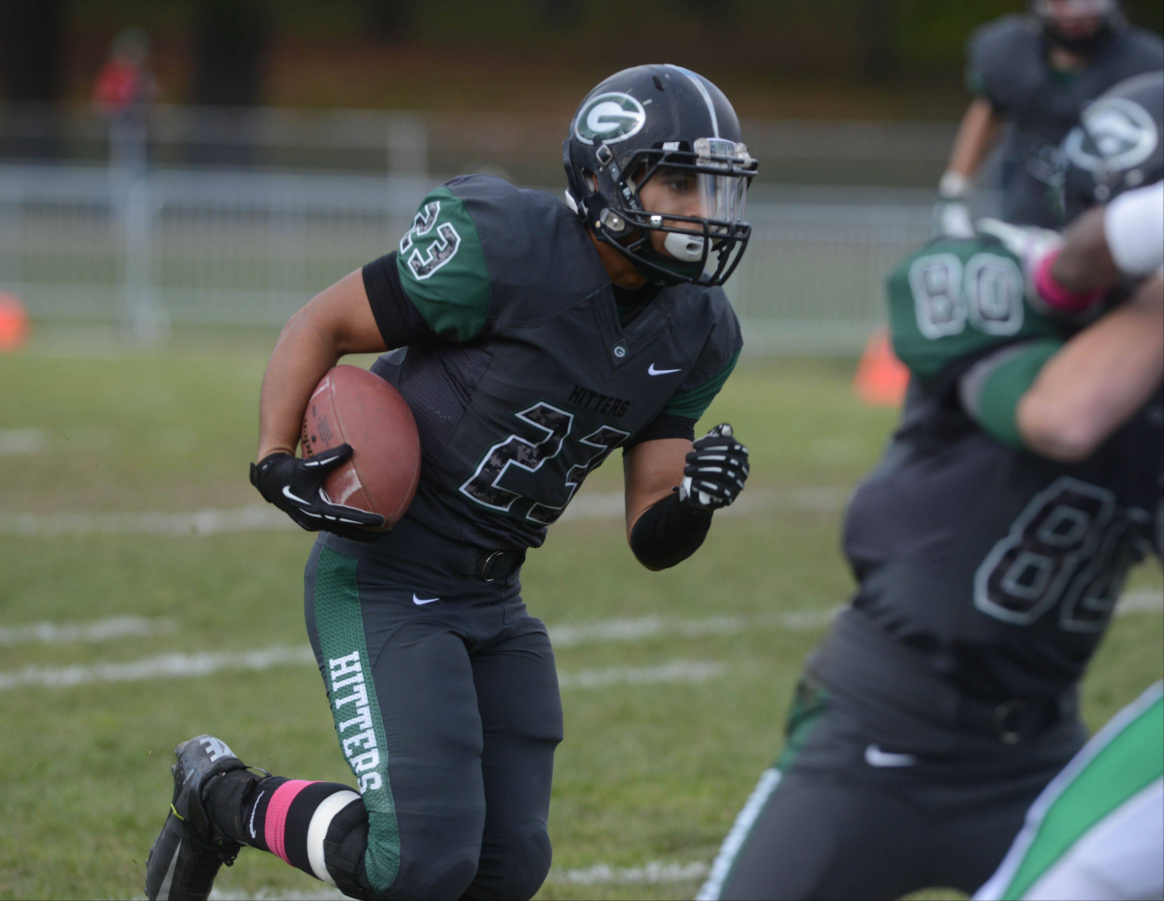 Scott Andrews of Glenbard West moves the ball during the York at Glenbard West football game Saturday.
