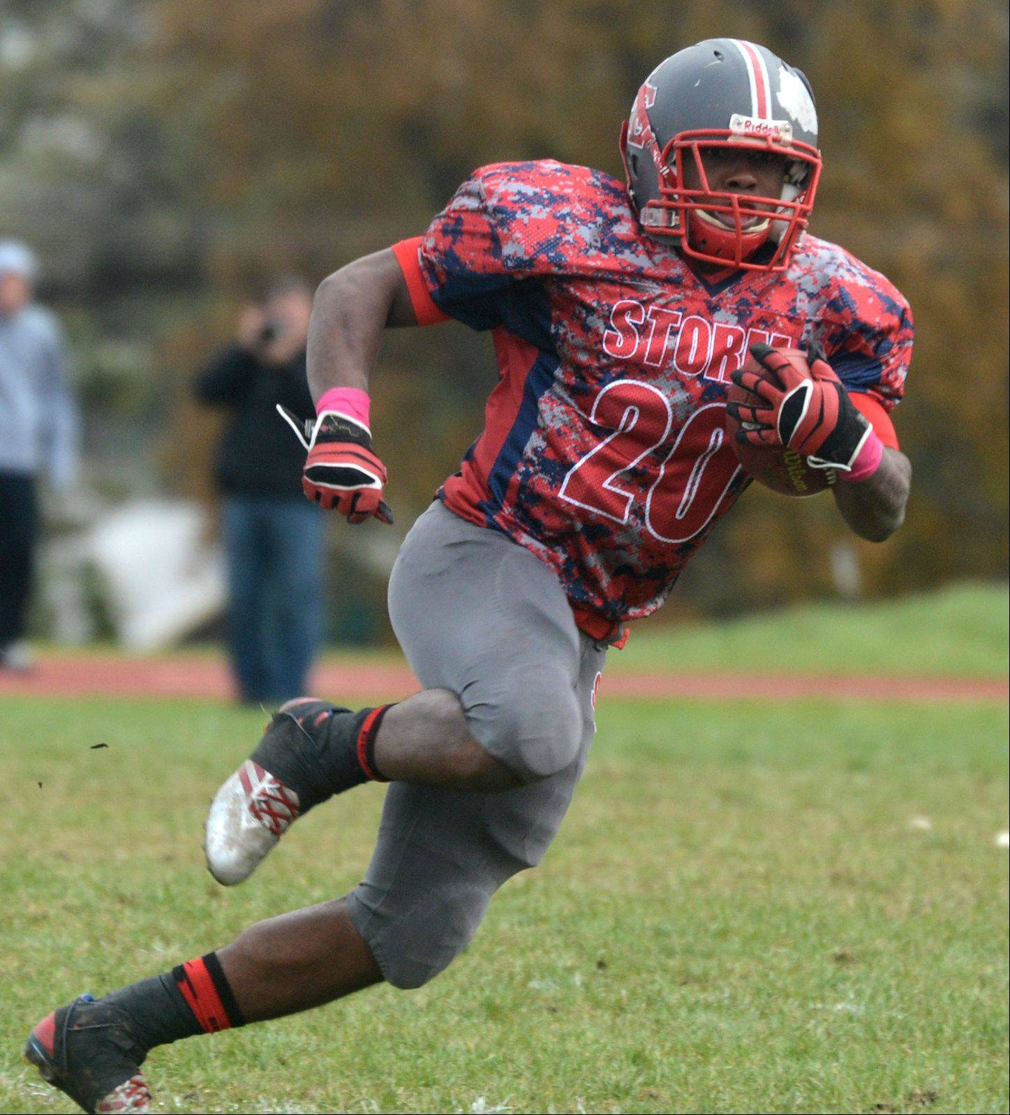 South Elgin's Shawn Griffin runs the ball against St. Charles North at South Elgin on Saturday.