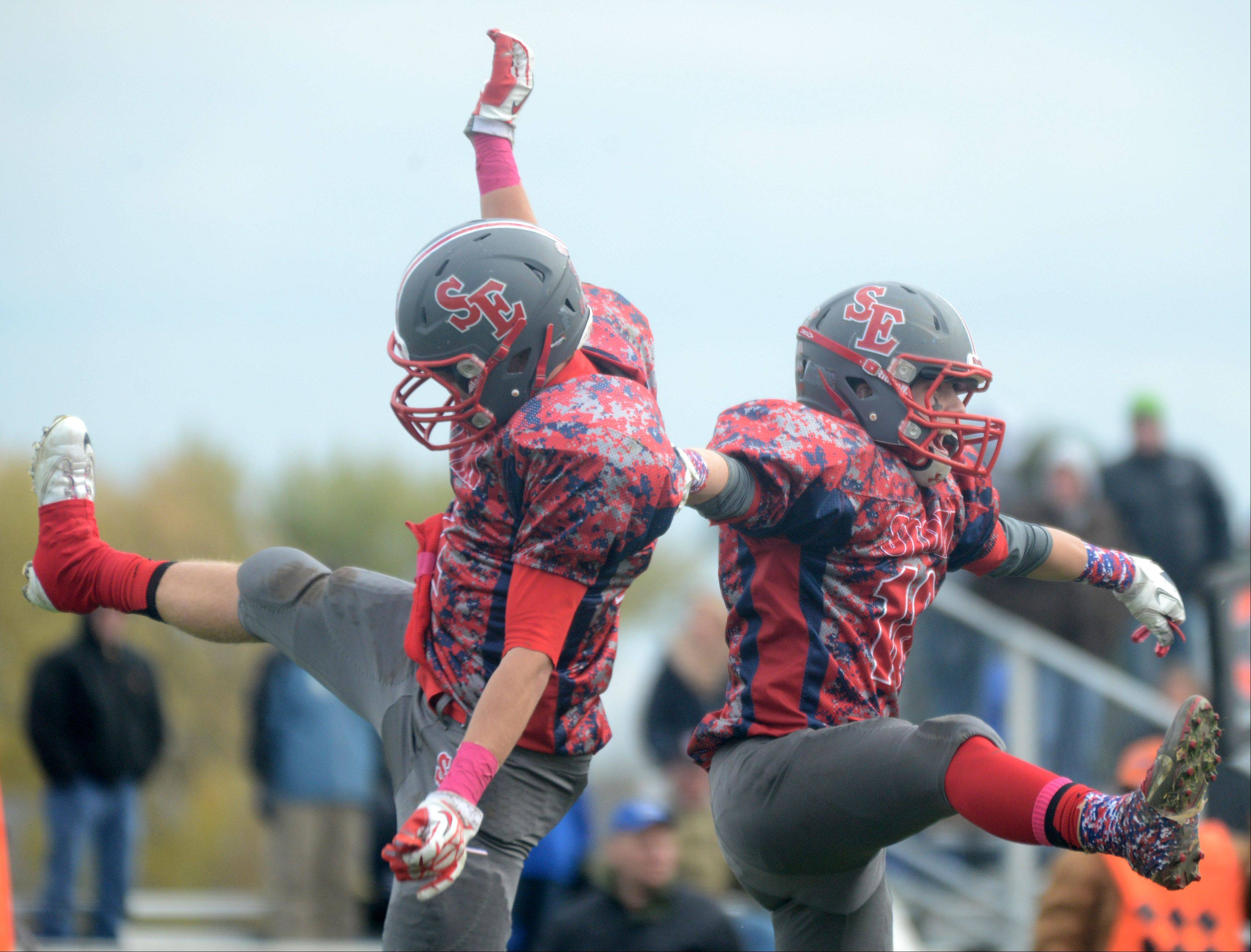 South Elgin's Andrew Kamienski, left, and Nick Menken, right, celebrate a Menken touchdown reception against St. Charles North during a varsity football game at South Elgin on Saturday.