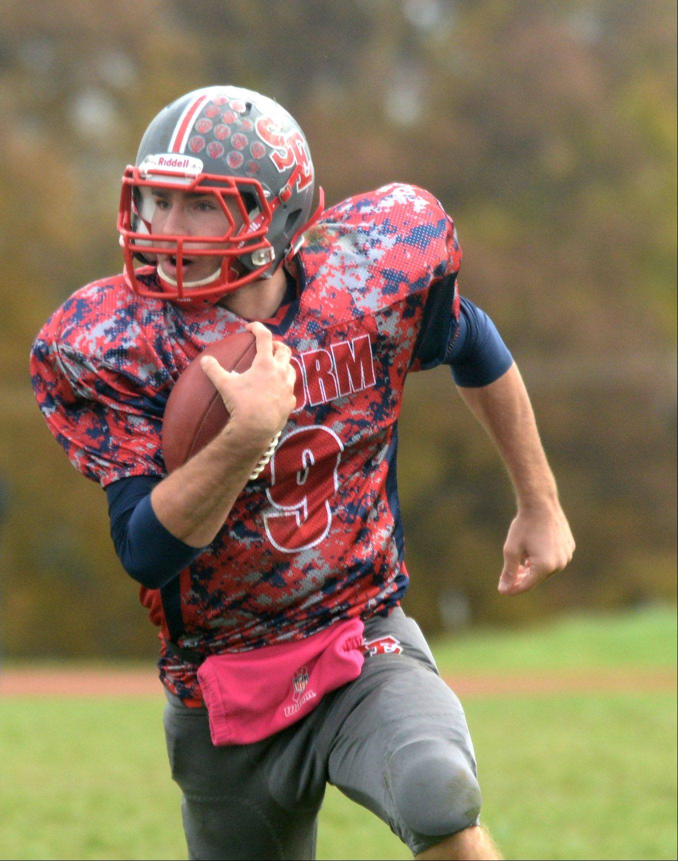 South Elgin quarterback Rob Cuda runs the ball against St. Charles North during a varsity football game at South Elgin on Saturday.
