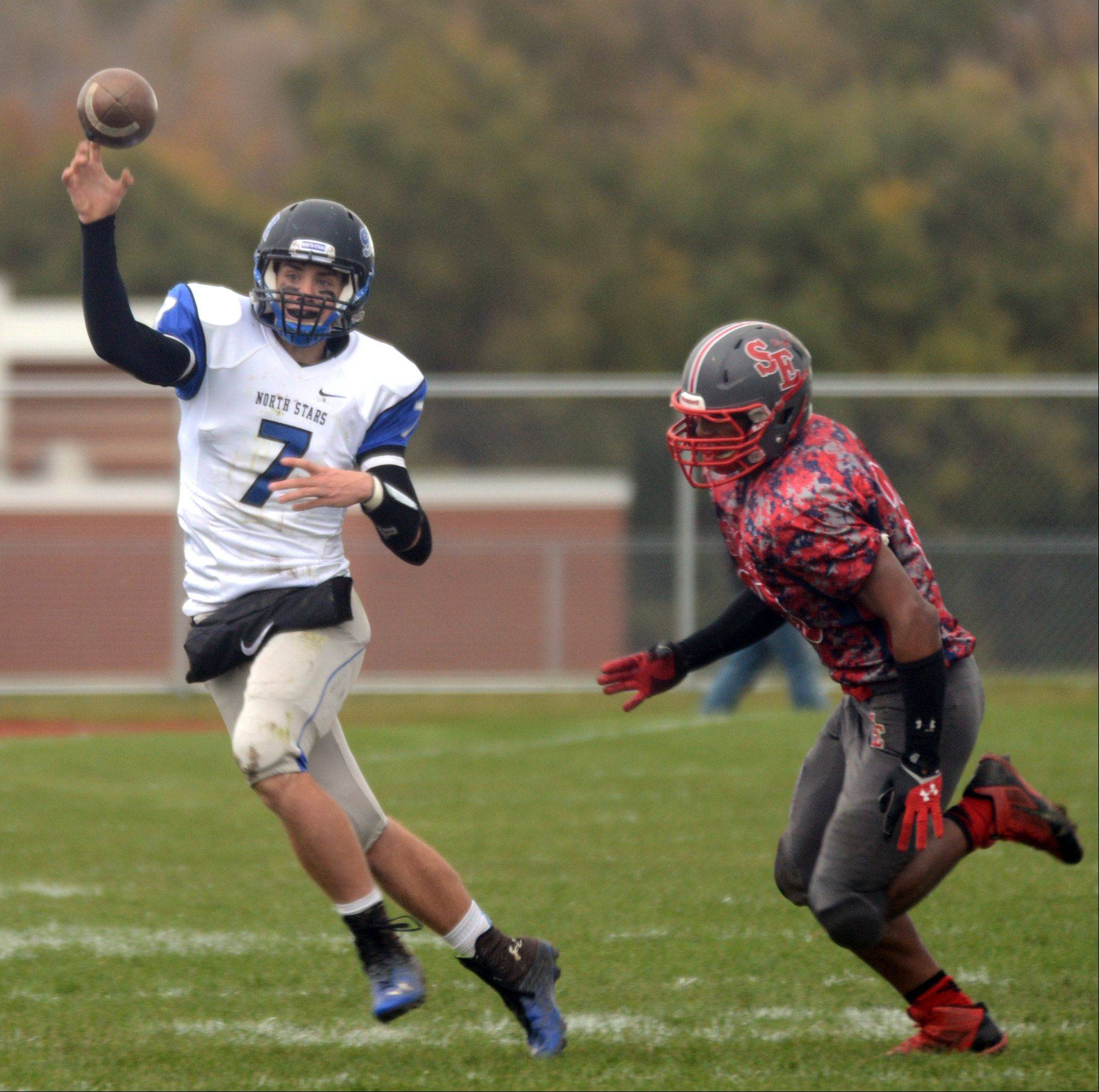 St. Charles North quarterback Erik Miller throws the ball during a varsity football game at South Elgin on Saturday.