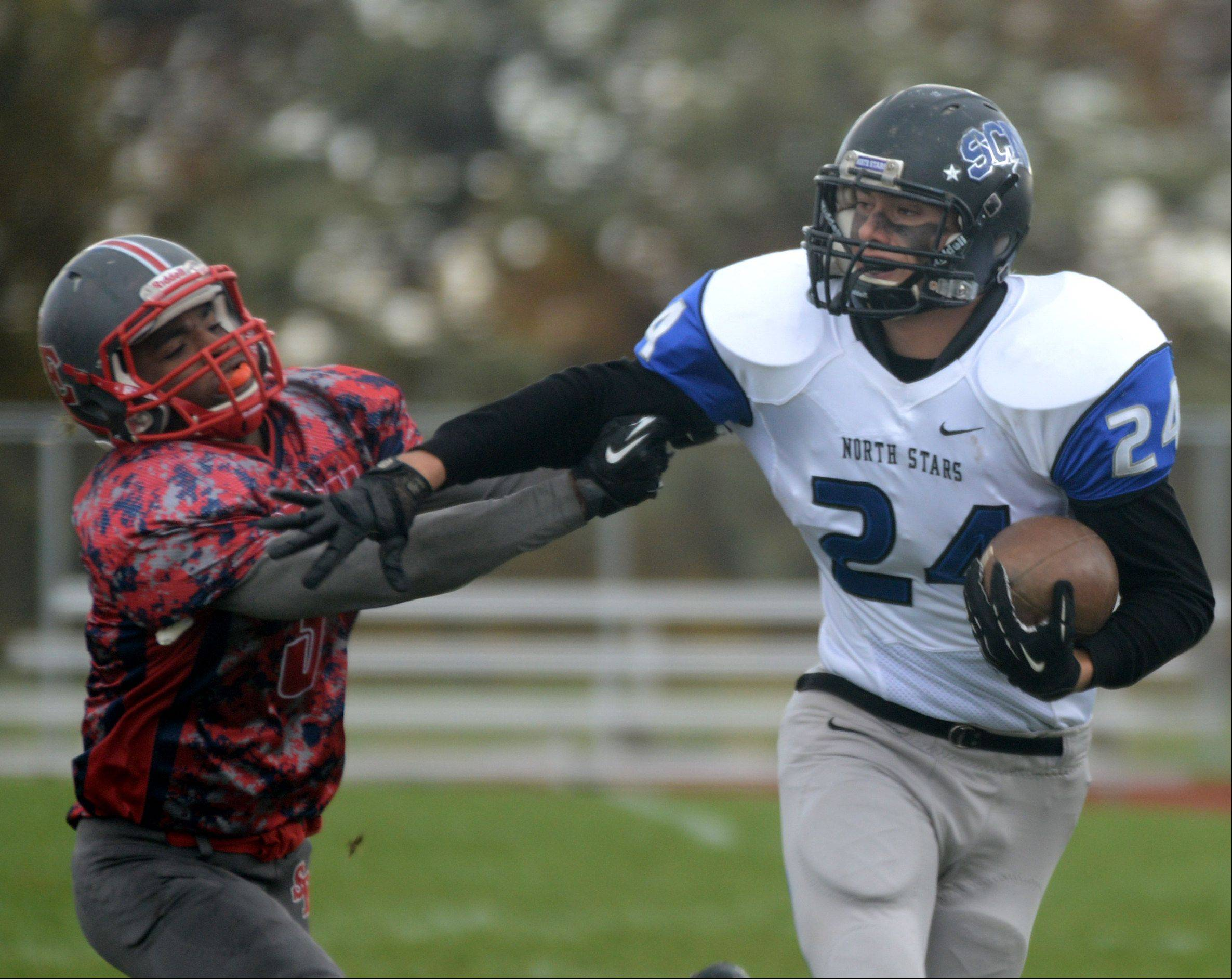 South Elgin's TeQuan Cager, left, pursues St. Charles North's Evan Kurtz .