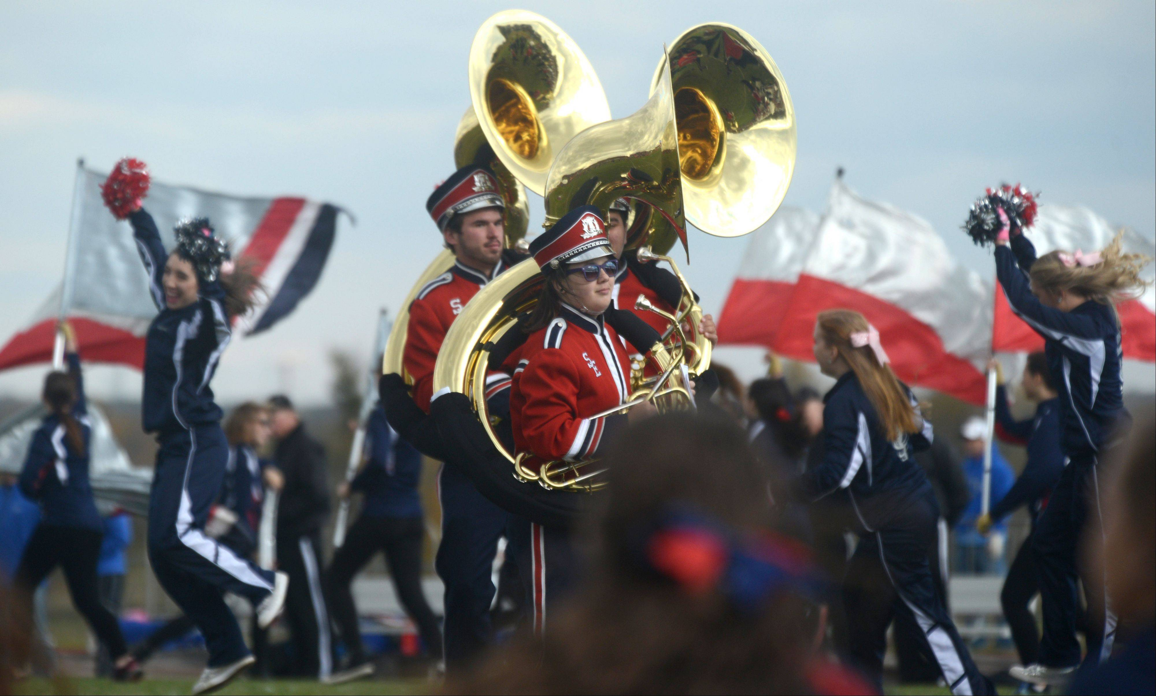 South Elgin High School band members and cheerleaders perform before a varsity football game against St. Charles North at South Elgin on Saturday afternoon.