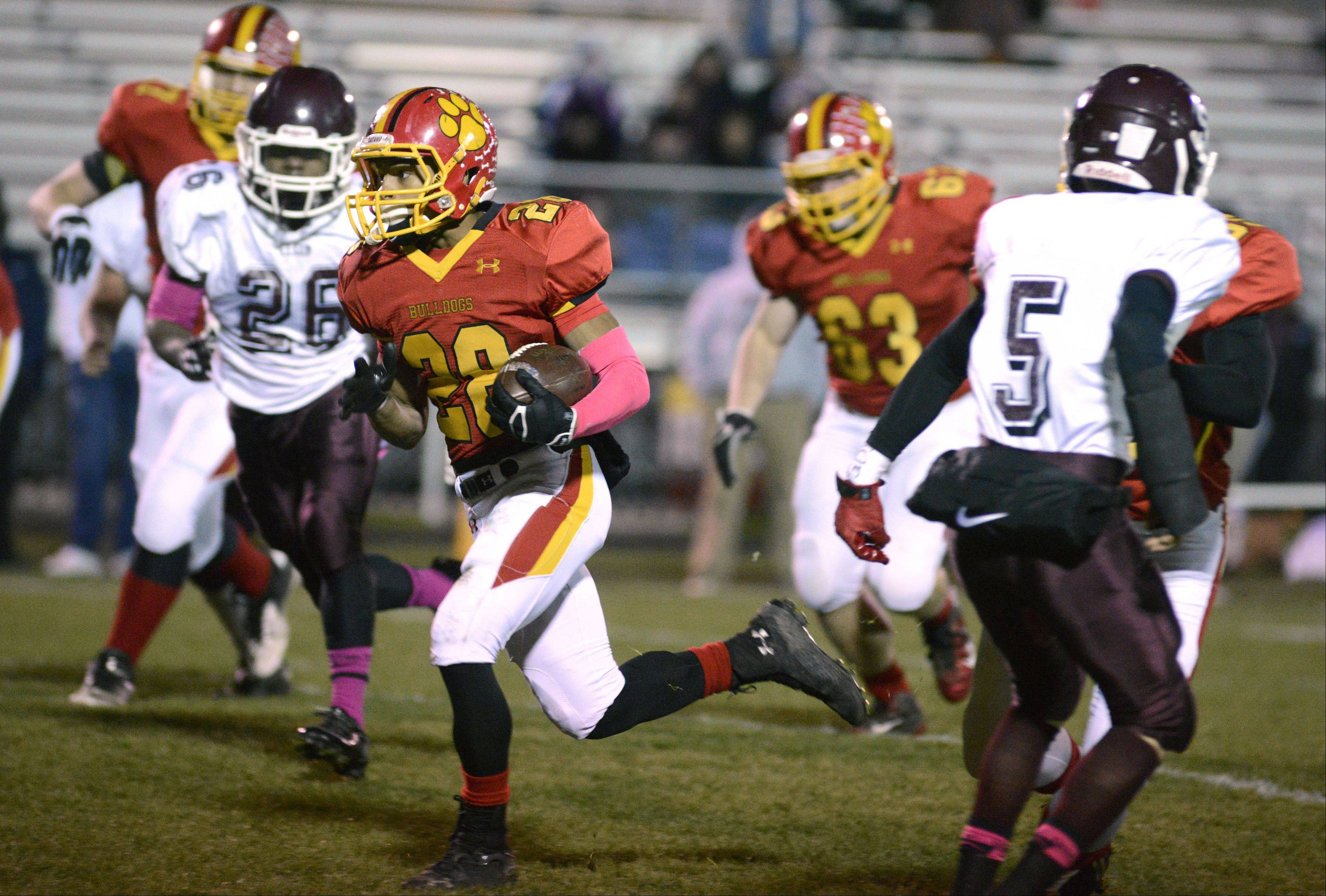 Batavia's Anthony Scaccia makes his way down to scoring a touchdown in the first quarter vs. Elgin on Friday, October 25.