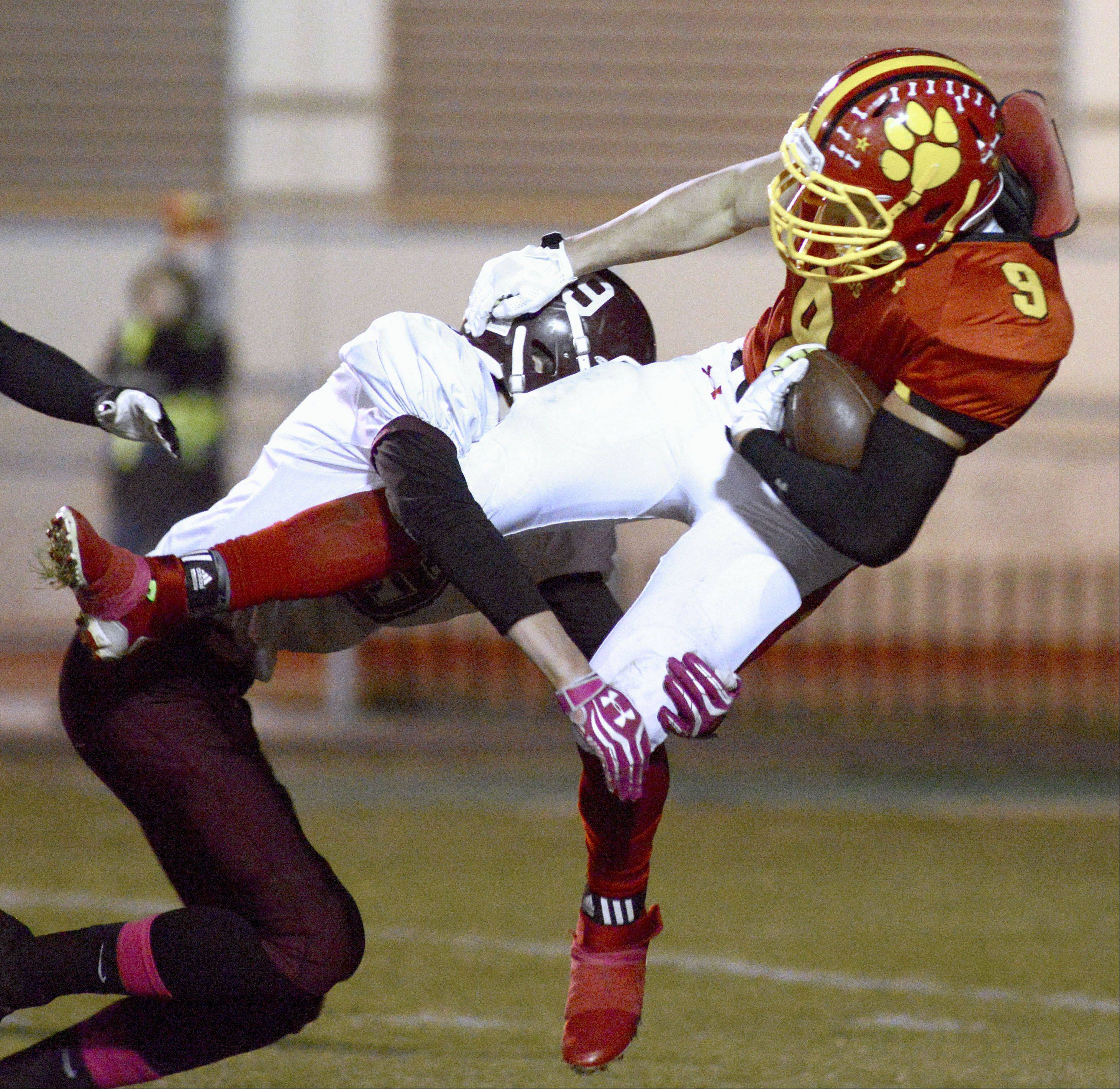 Batavia's Anthony Moneghini is taken down by Elgin's Michael Behining in the second quarter on Friday, October 25.
