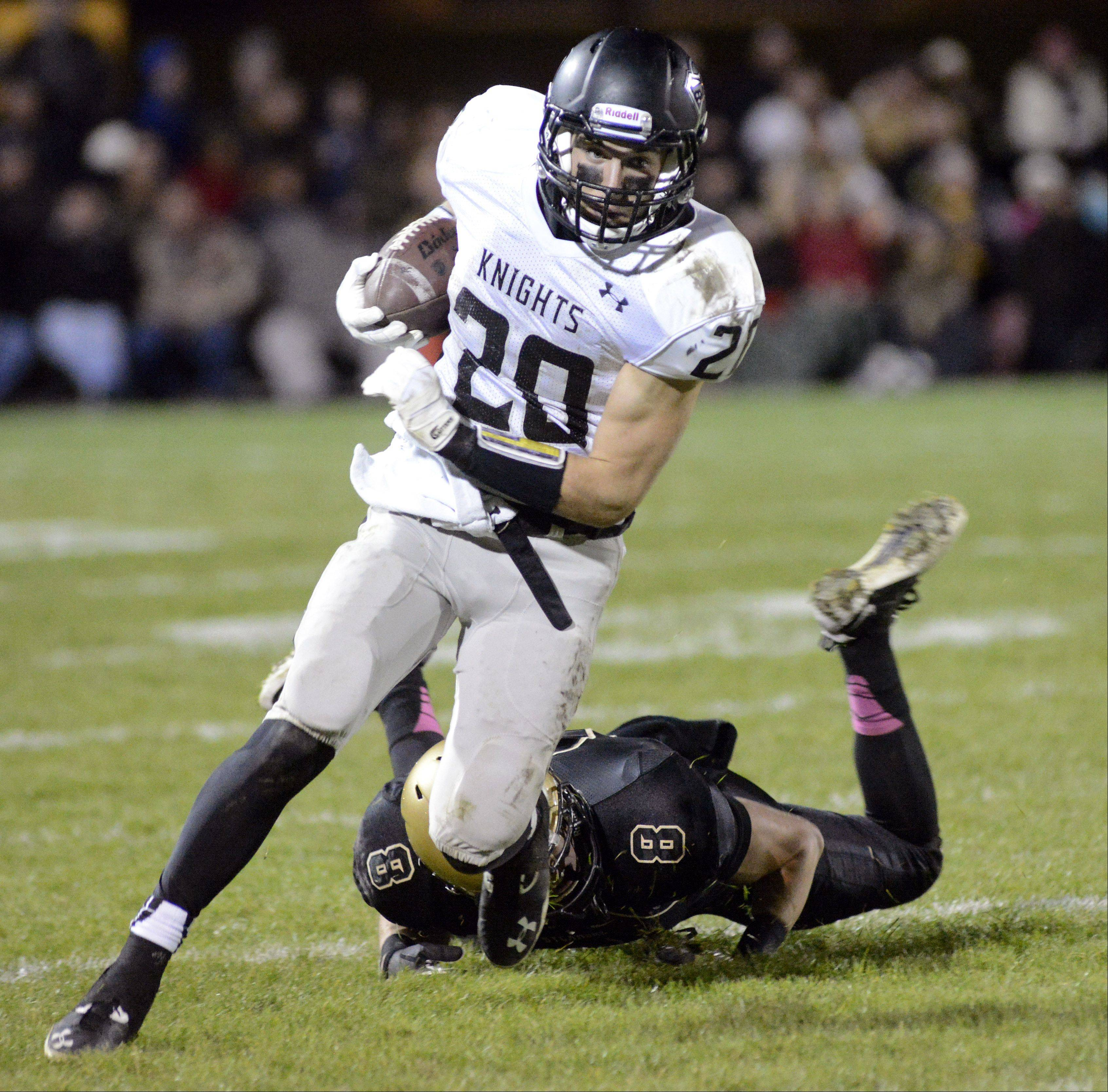 Kaneland's Dylan Nauert shakes off Sycamore's Ben Niemann in the second quarter on Friday, October 18.