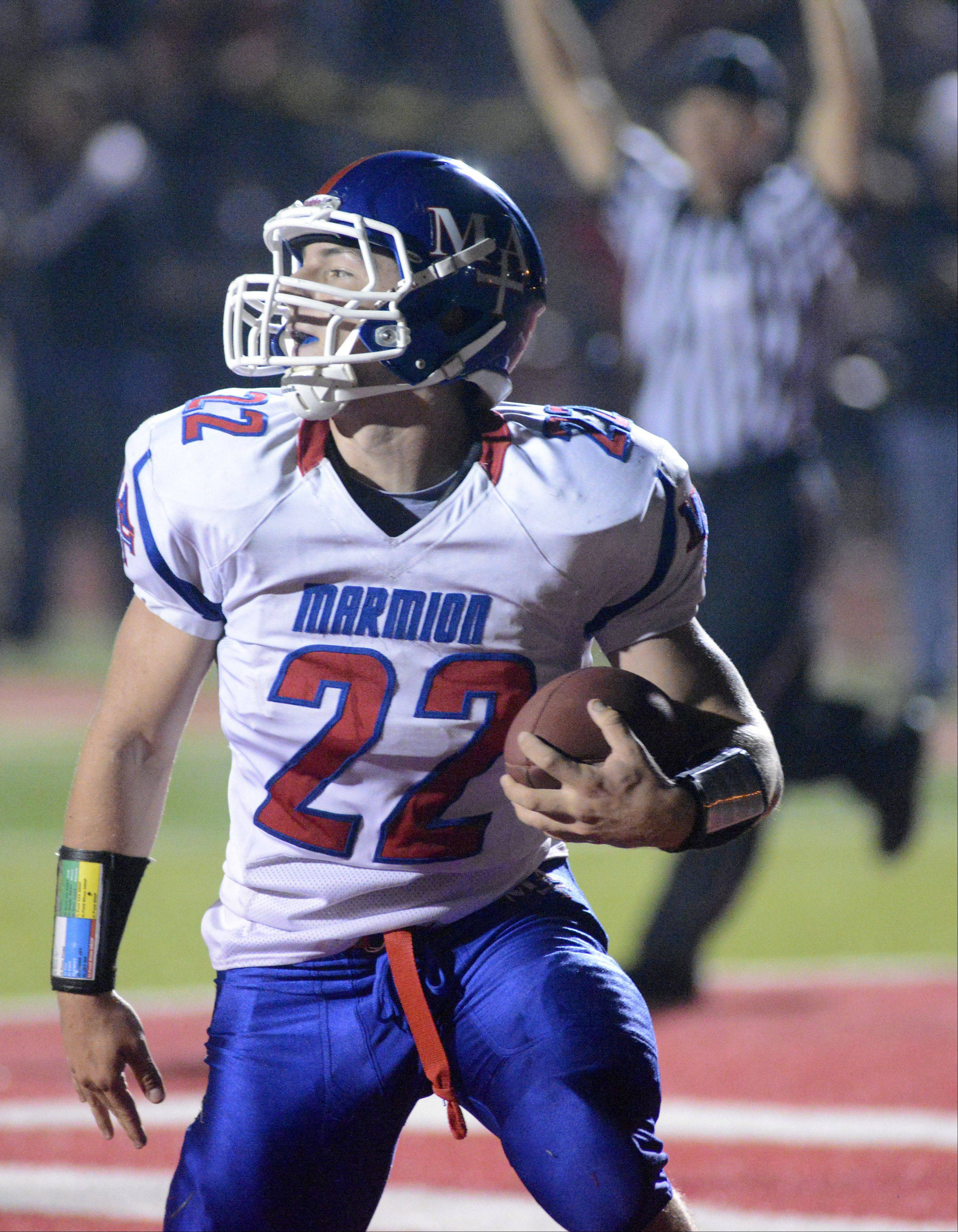 Marmion Academy's Jordan Glasgow scores a touchdown in the first quarter on Friday, October 4.