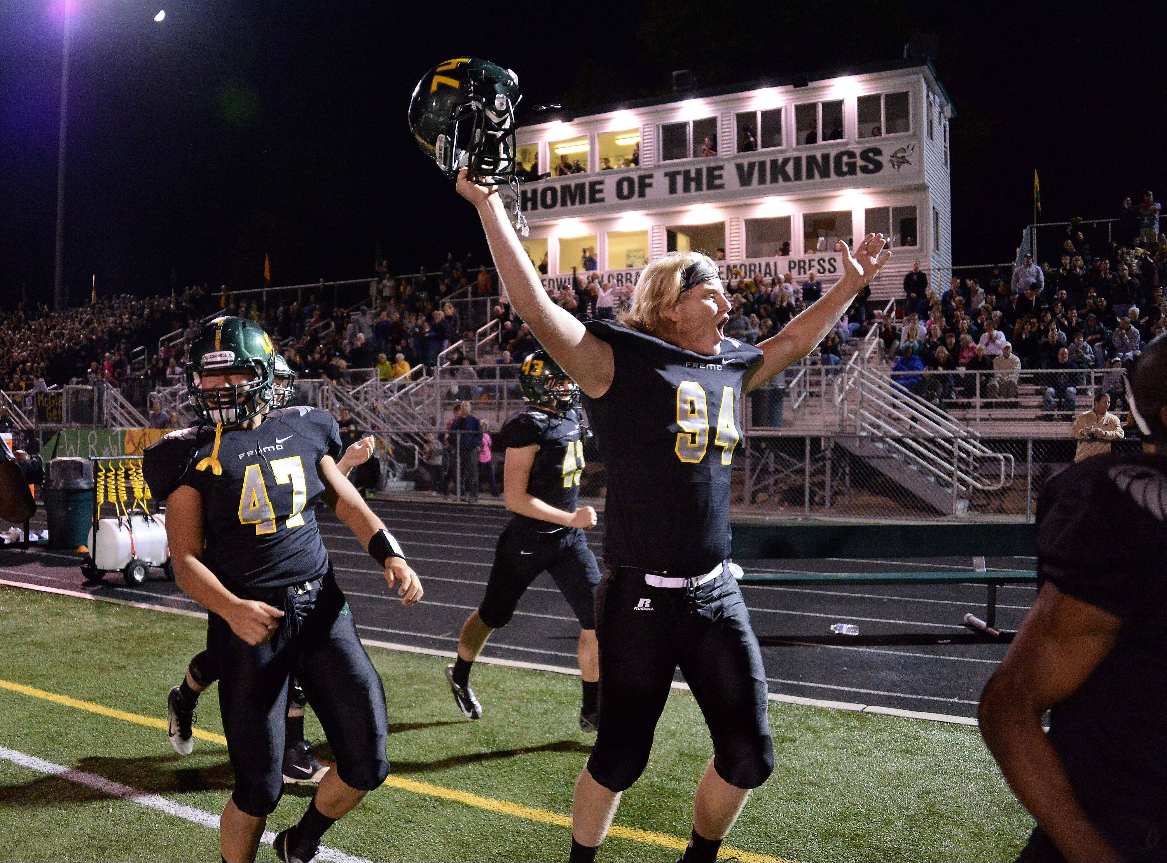 Fremd's Jack Albrecht and the rest of his teammates start to celebrate their victory over Palatine earlier this season. Fremd will host Niles Notre Dame Friday in the first round of the Class 8A playoffs.