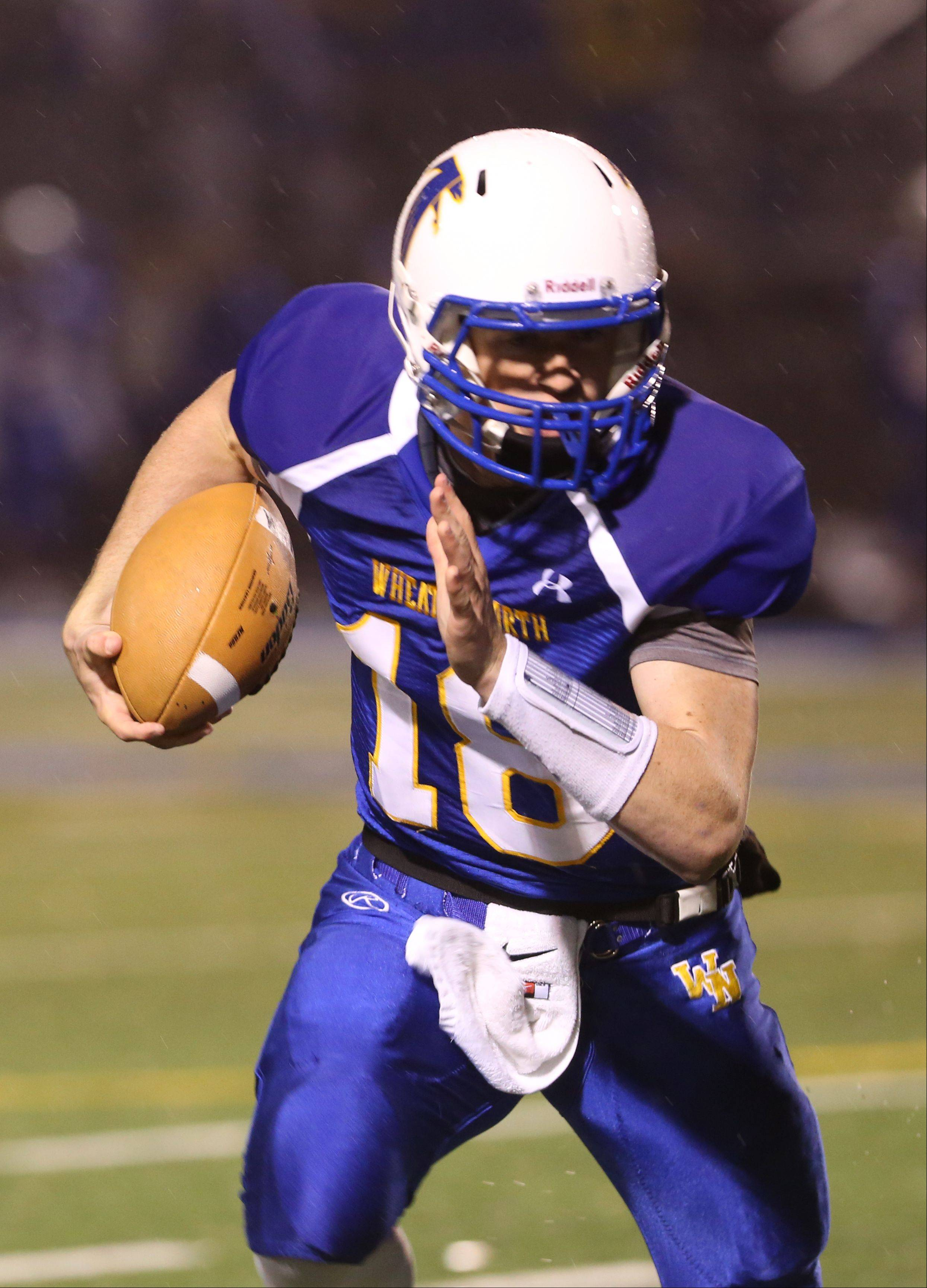Wheaton North quarterback Clayton Thorson looks for running room against Glenbrook North.