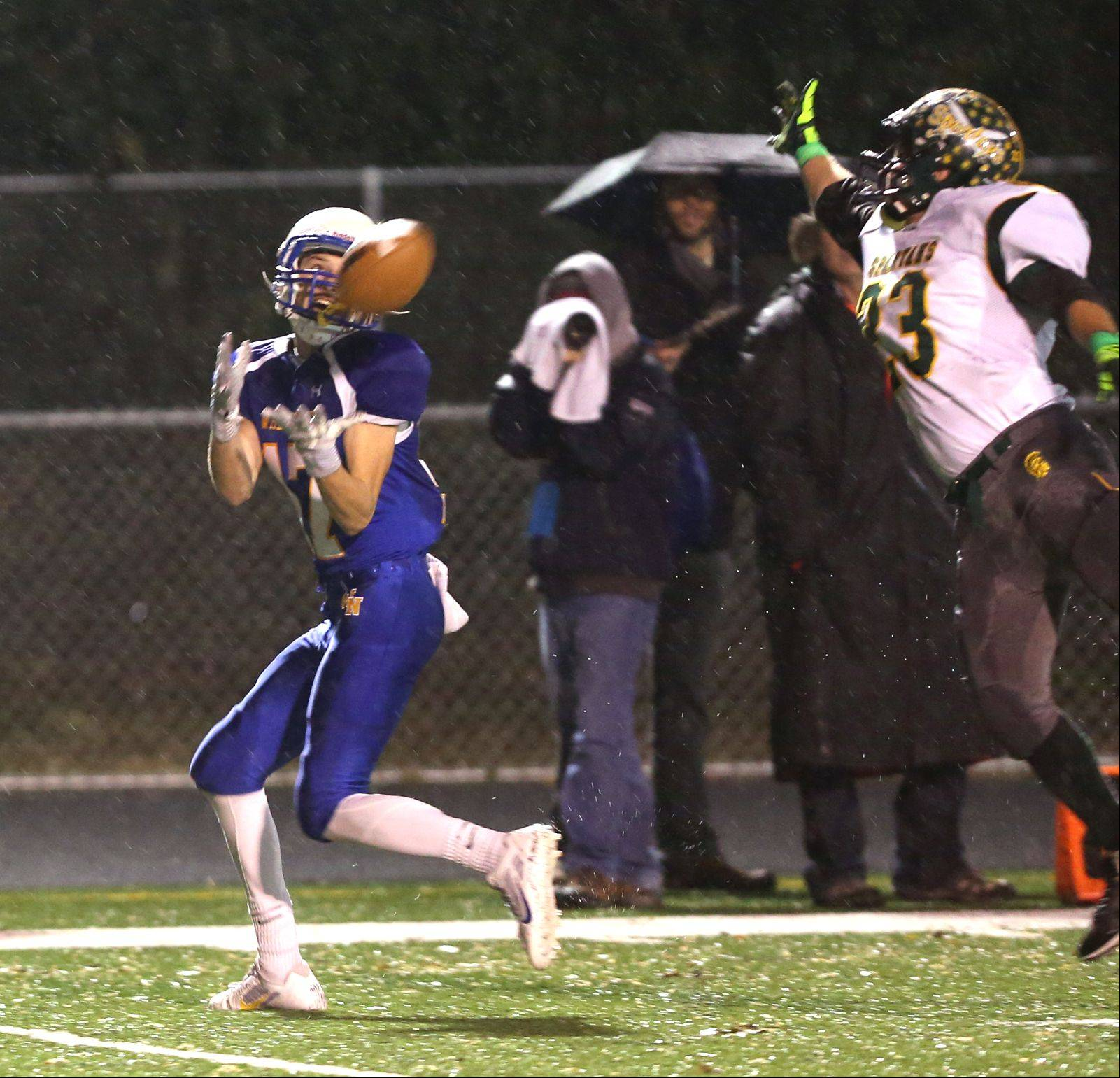 Wheaton North's Michael Bloss, left, catches his second first-half touchdown pass.