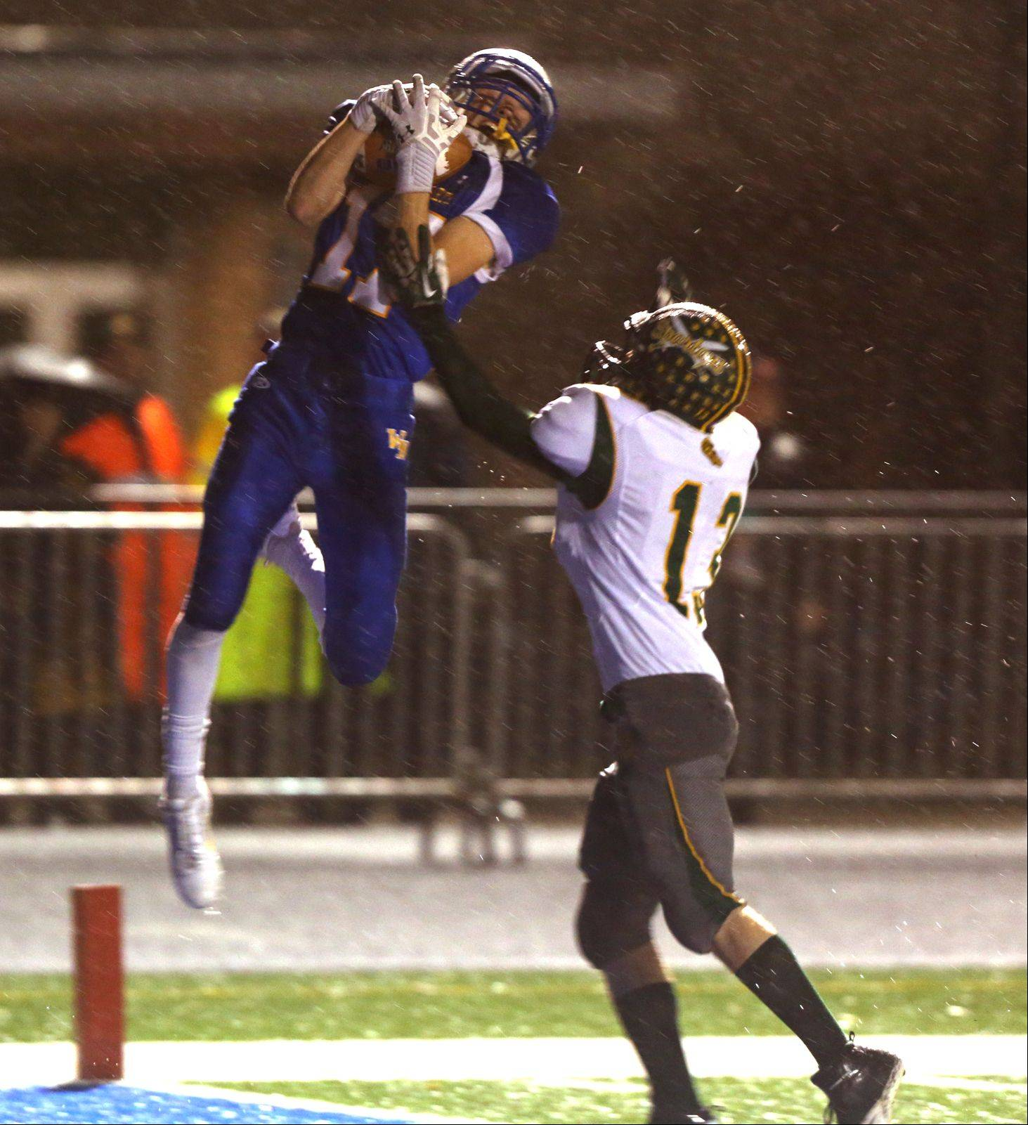Wheaton North's Michael Bloss, left, catches a first half touchdown pass over Glenbrook North's Brice Call.