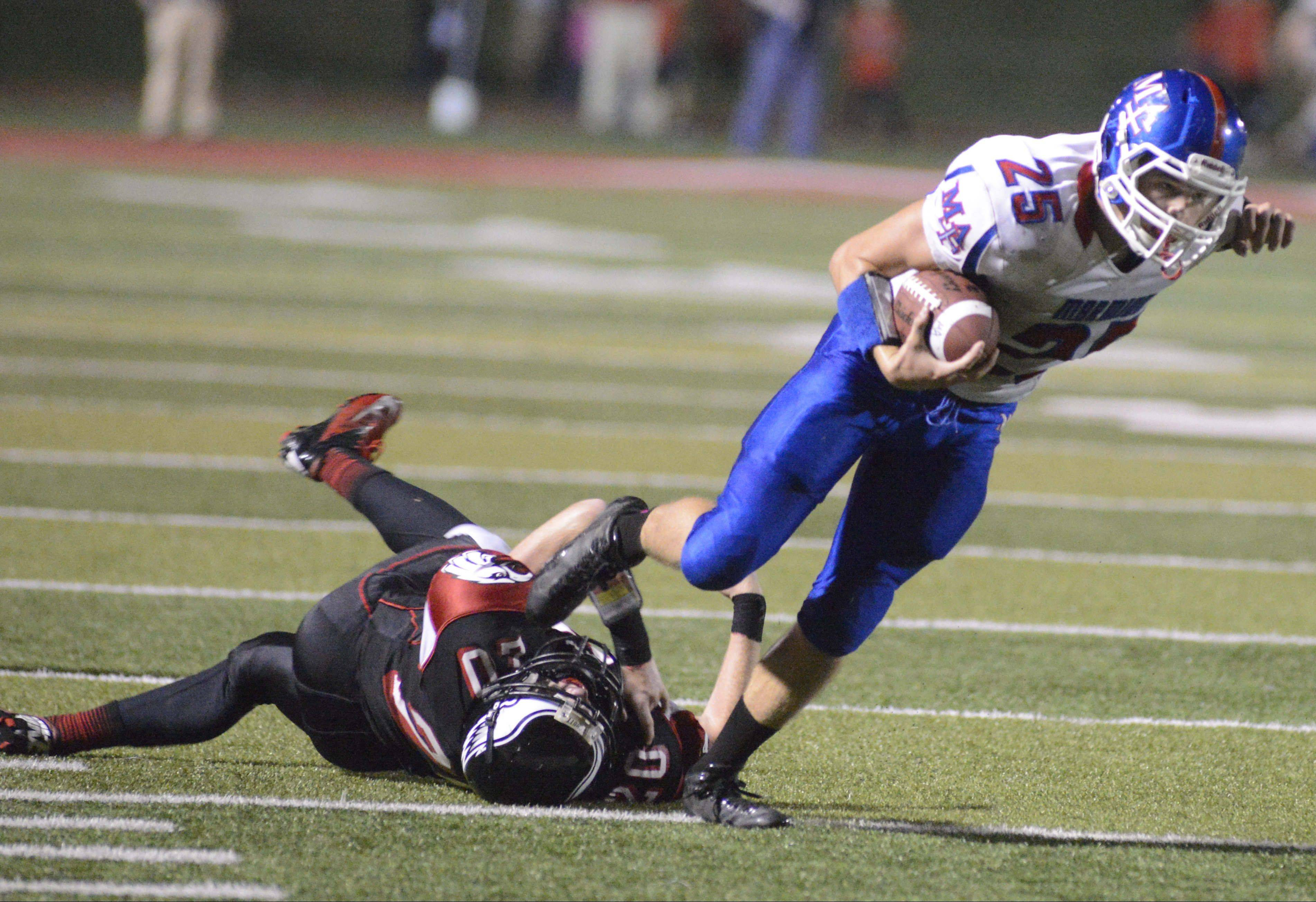 Sam Breen fights for yards for Marmion during the Cadets' win over Aurora Christian this season. Marmion starts Class 6A playoff action Friday when it hosts Fenton.