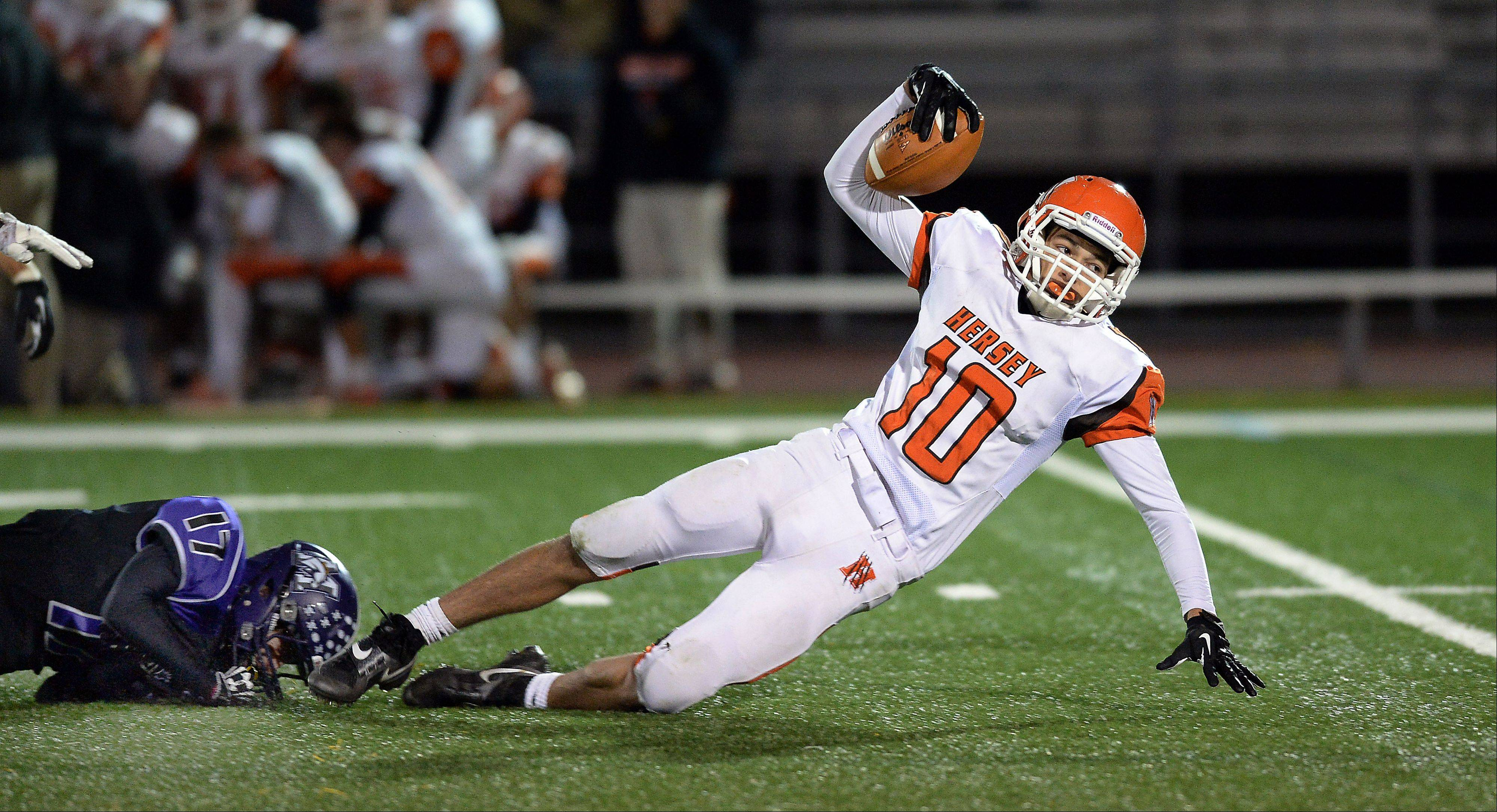 Hersey's Eddie Miklasz has made a habit of stretching defenses this season. Here Rolling Meadows' Kevin Adair makes a shoestring tackle in a matchup of Mid-Suburban East co-champs.