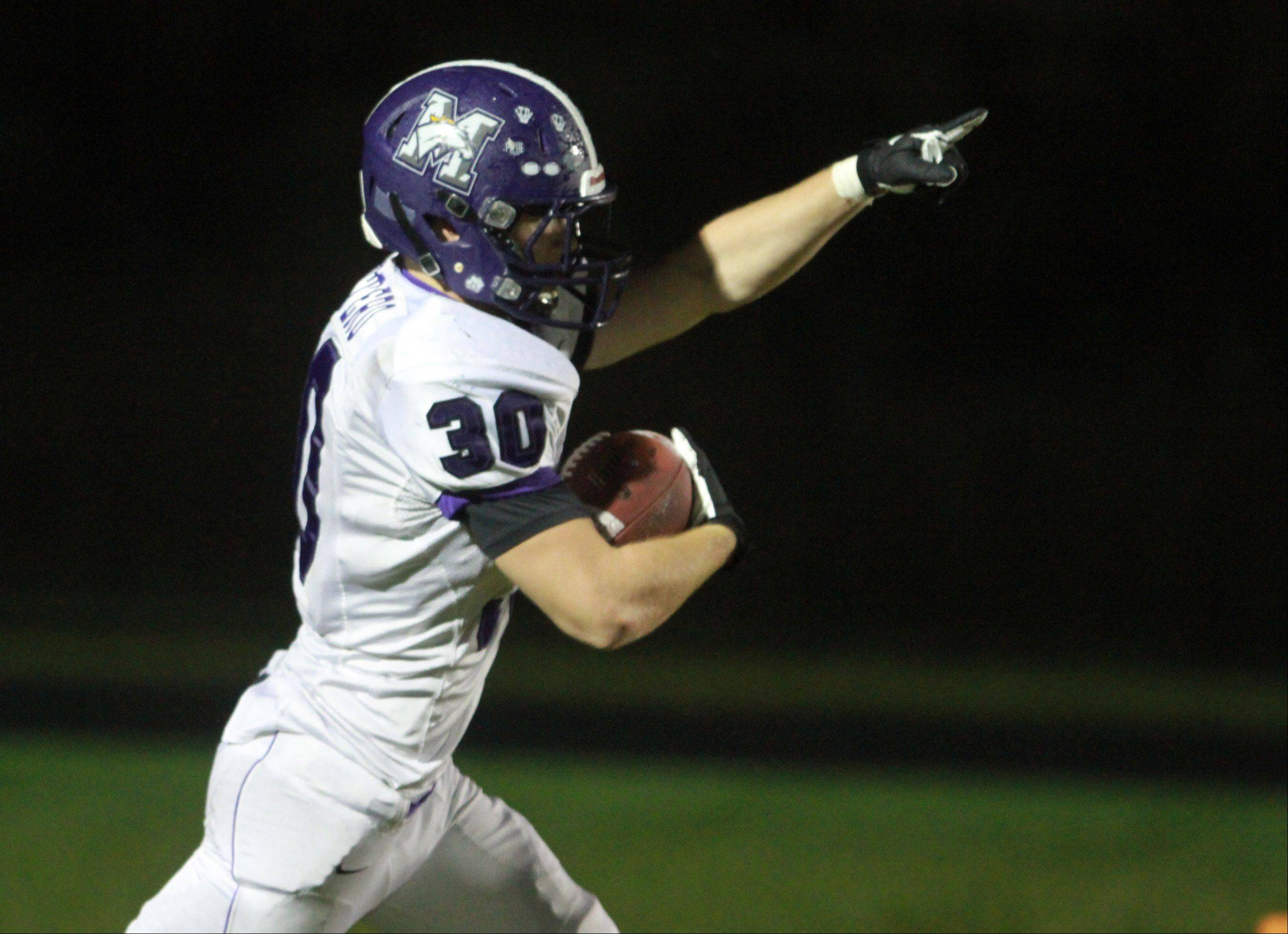 Rolling Meadows Kevin Montero celebrates scoring a touchdown against Grayslake North in Class 6A playoff action at Grayslake North on Friday.