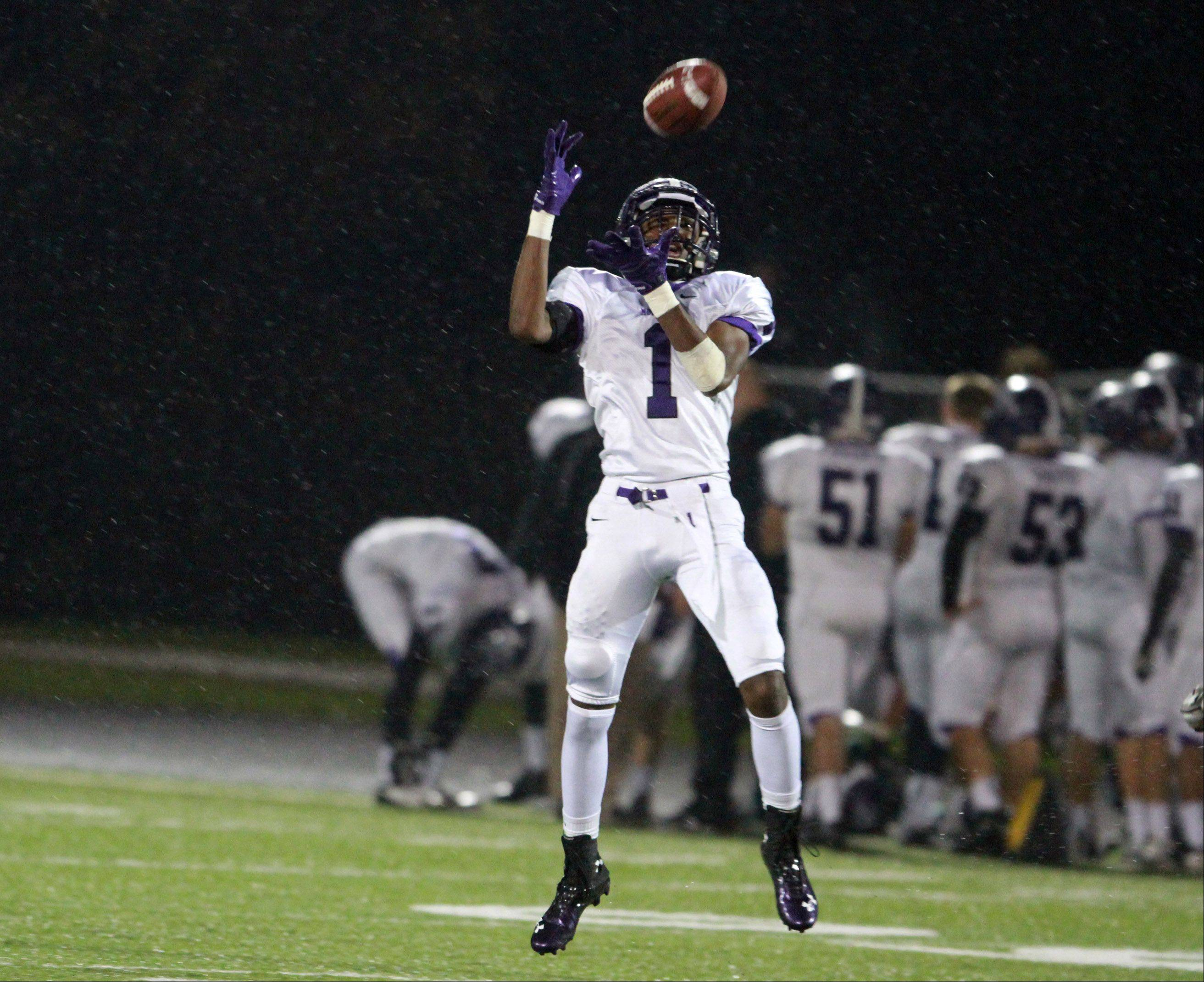 Rolling Meadows' Romello Boykin catches this pass from Bobby Suchecki against Grayslake North on Friday.