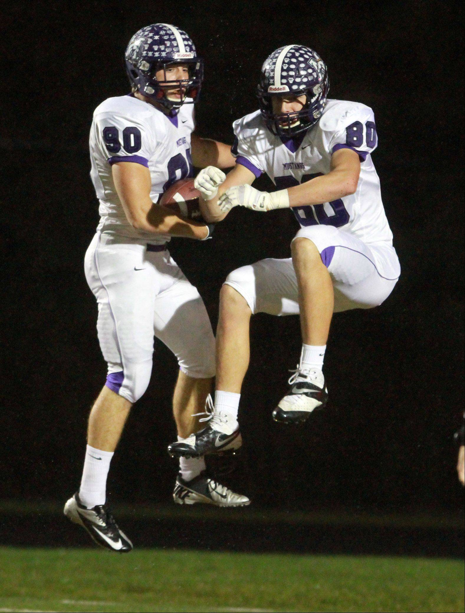 Rolling Meadows receiver Matt Campbell, left, celebrates scoring the first touchdown of the game against Grayslake North with teammate Matt Dolan in a Class 6A playoff opener at Grayslake North on Friday.