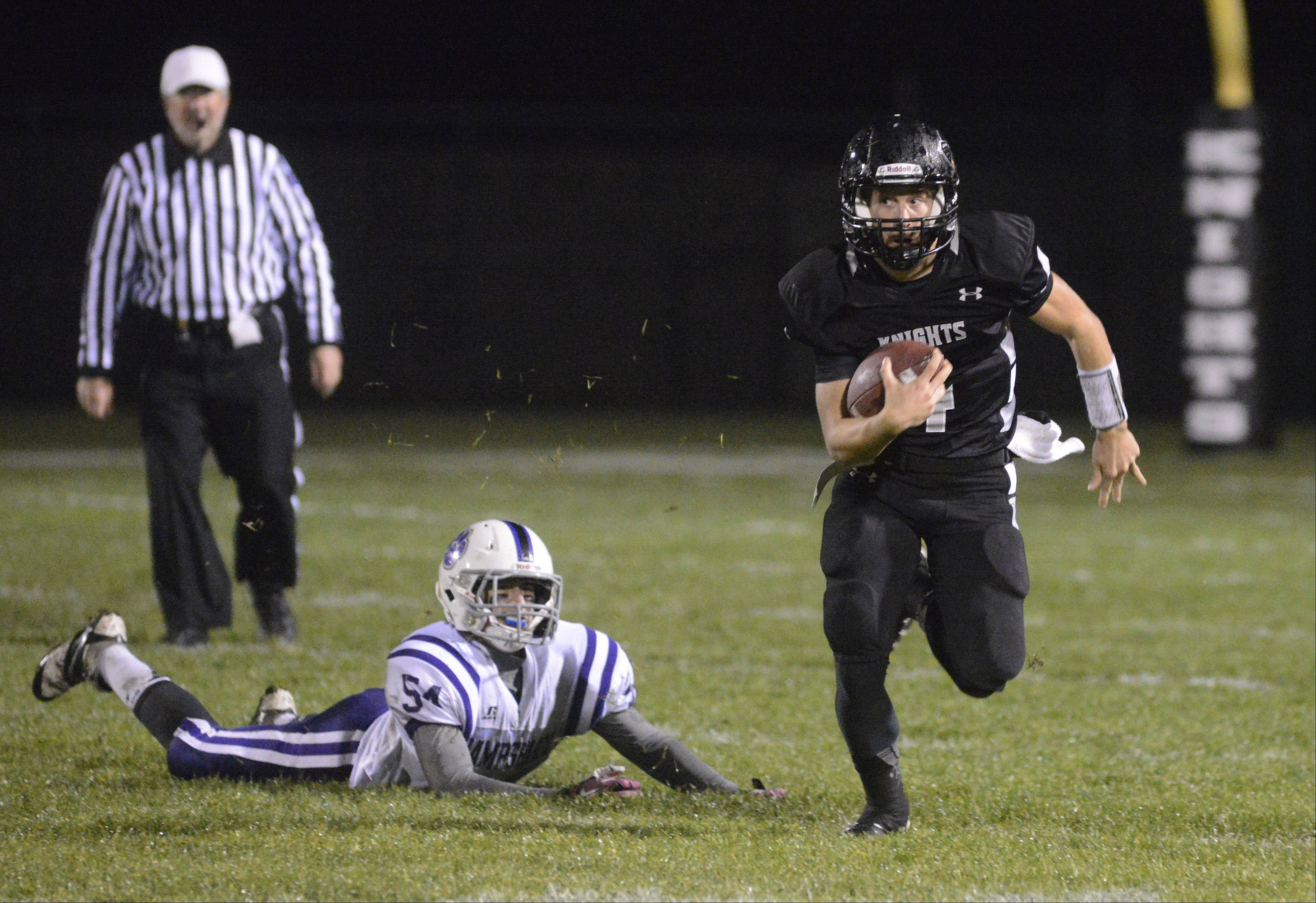 Kaneland's Drew David shakes Hampshire's Mike Palazzolo off in the first quarter on Friday, November 1.