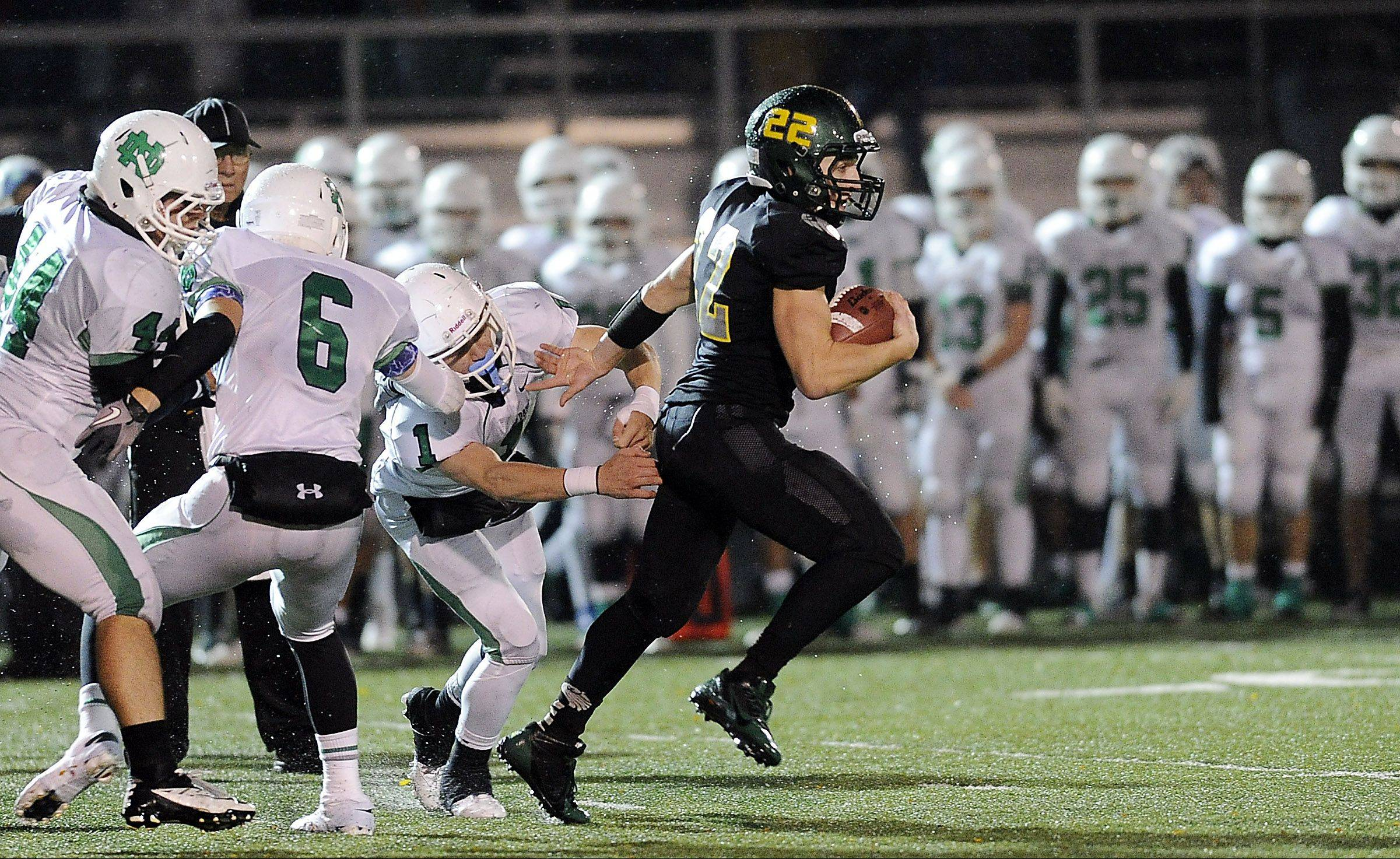 Fremd's Garrett Groot scrambles for a 44-yard run in the second quarter against Notre Dame in Class 8A playoffs action at Fremd on Friday.