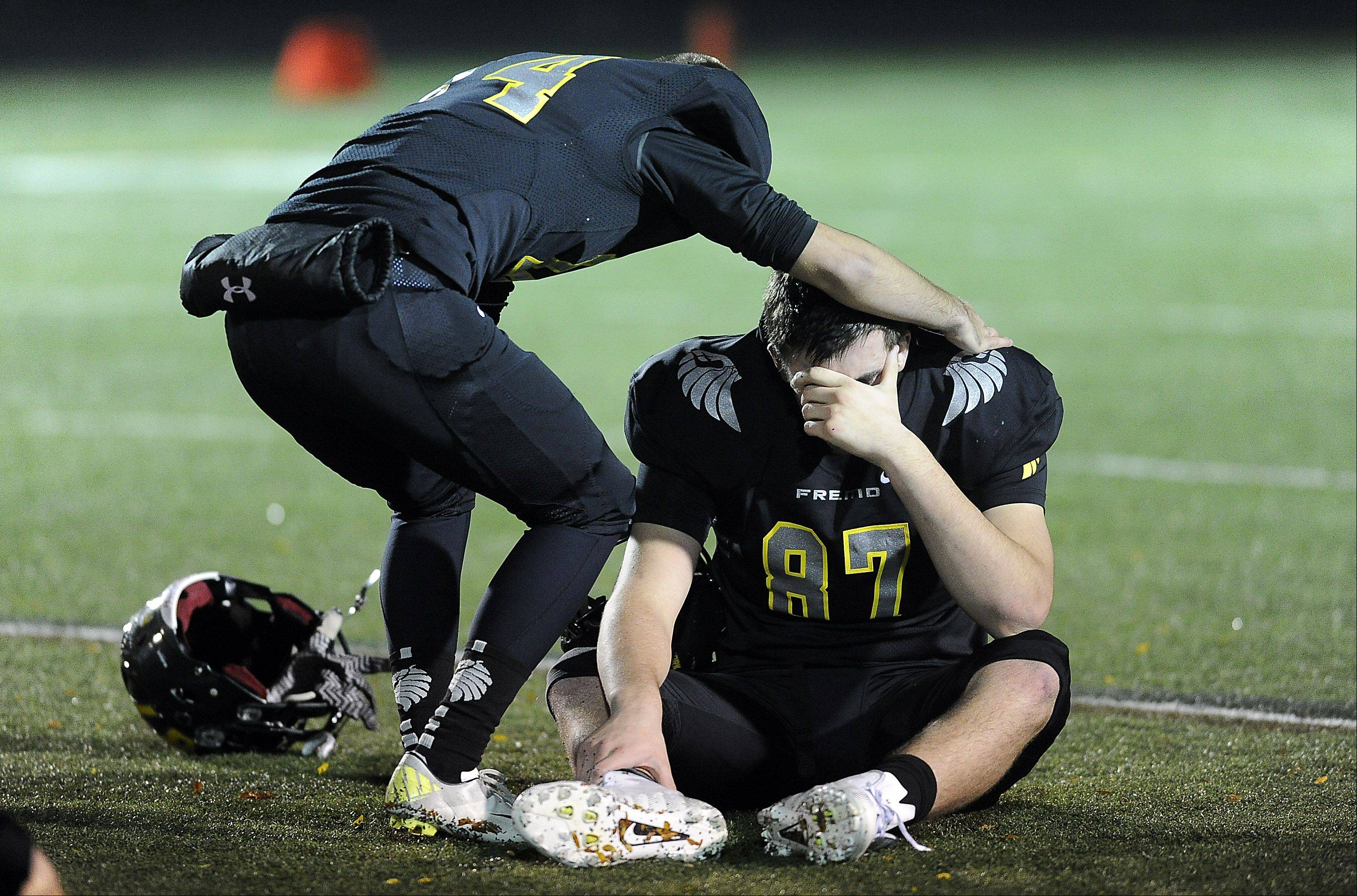 Mark Welsh/mwelsh@dailyherald.comFremd's Clayton Dukewich and teammate Andrew Stark feel the sting of a playoff exit after falling to Notre Dame on Friday.