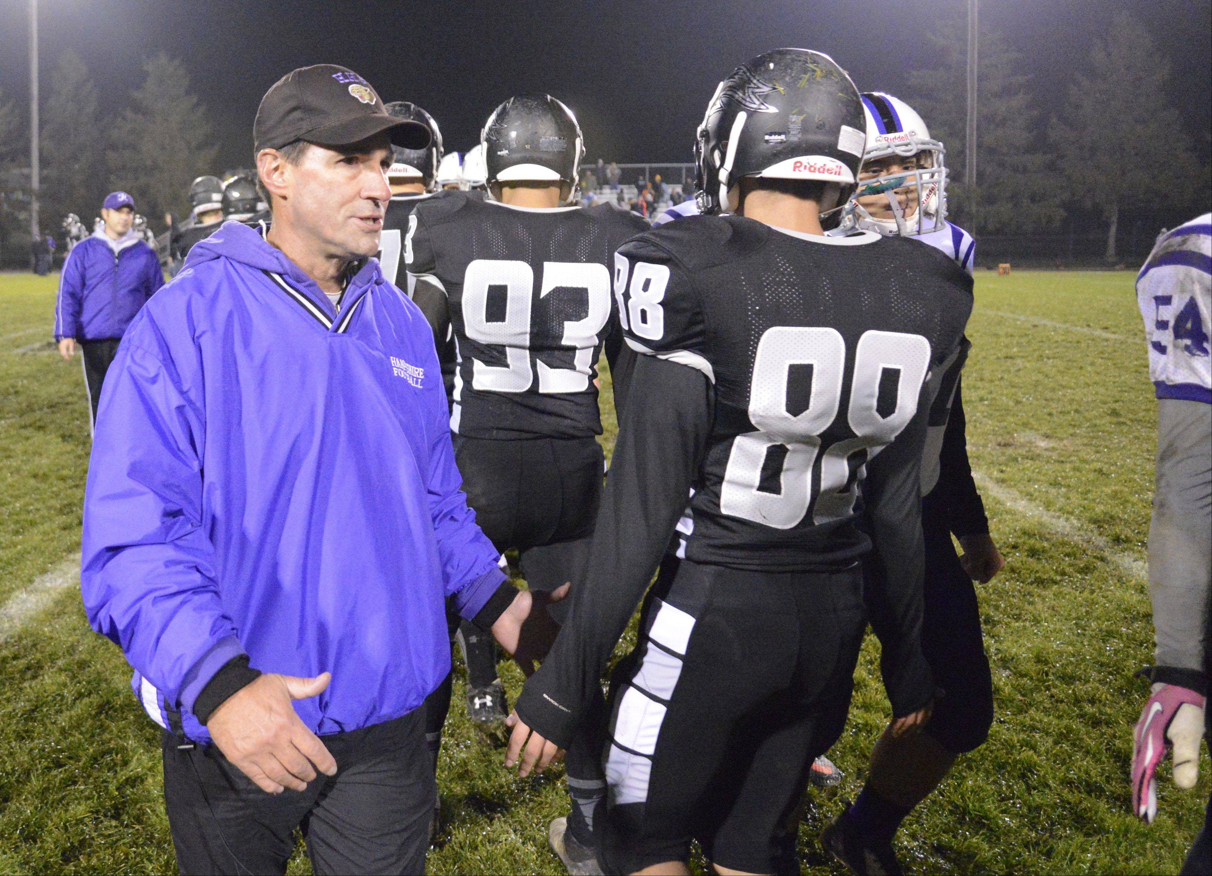 Hampshire head coach Dan Cavanaugh congratulates Kaneland players.