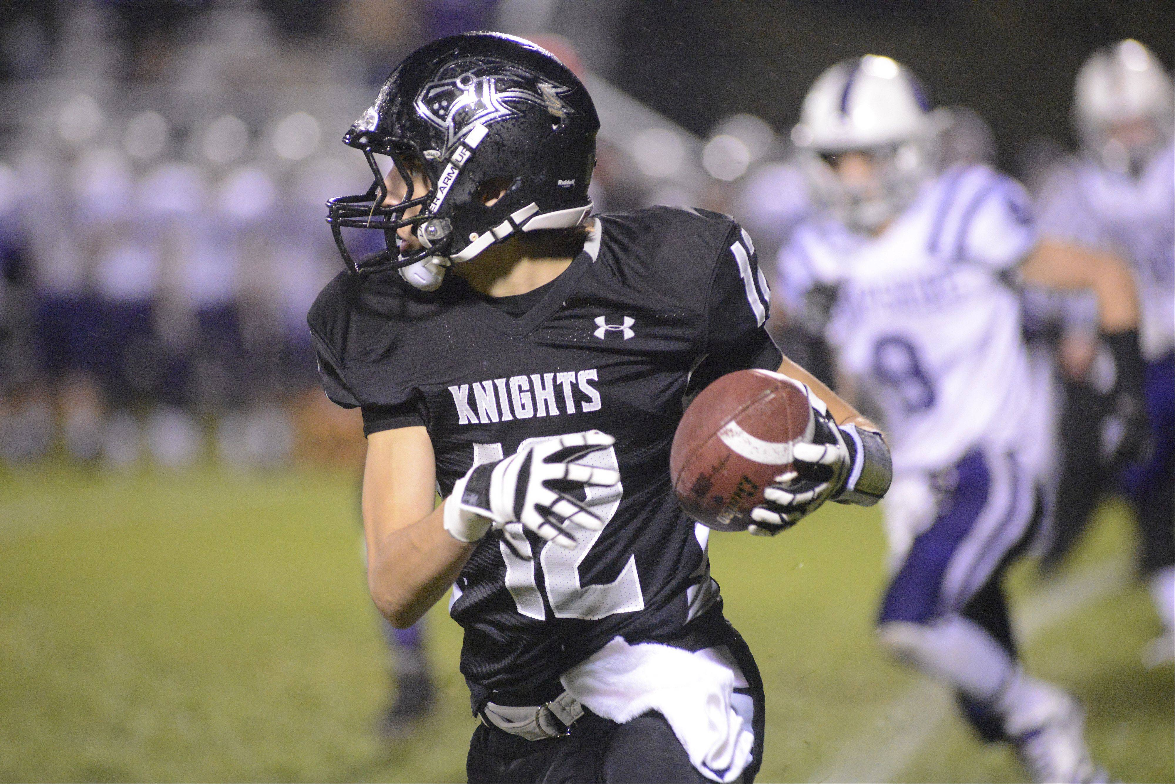 Kaneland's John Pruett makes his way down the field in the first quarter.