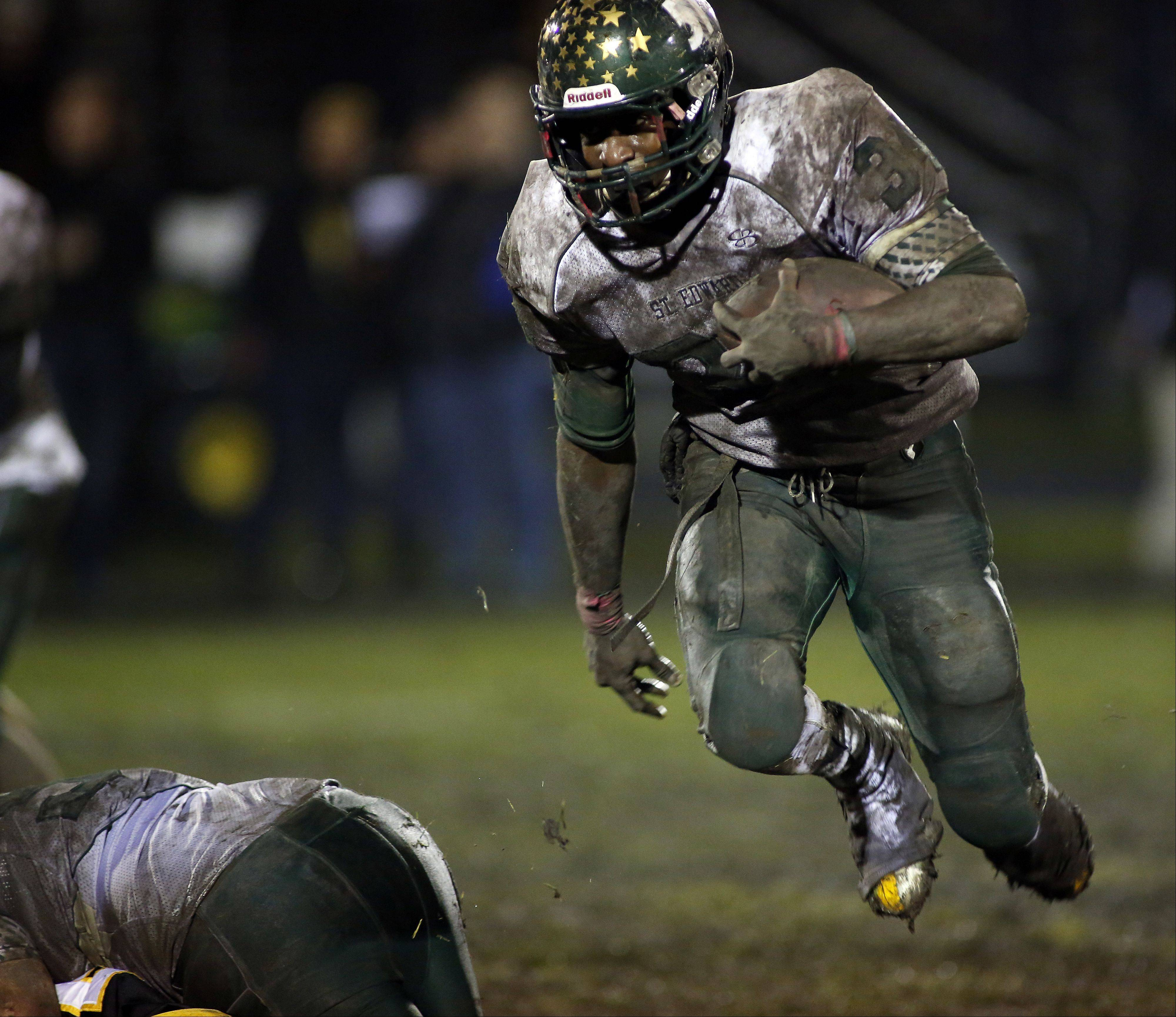 St. Edward's Davontae Elam (34) moves upfield against Harvard during the IHSA Class 4A playoff game Friday in Harvard. Elam finished his St. Edward career as the program's all-time leading rusher.