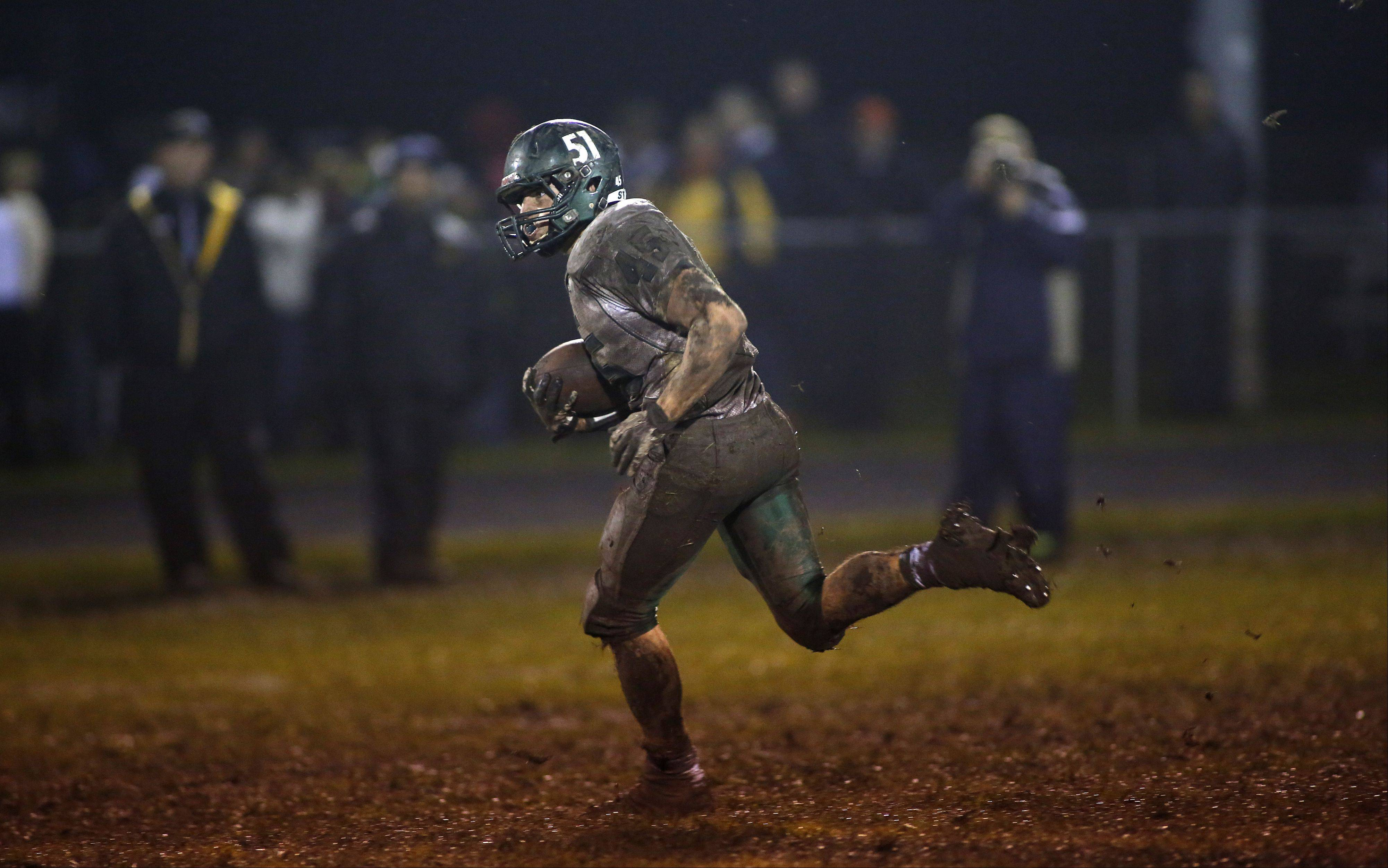 St. Edward's William Bothwell (45) looks for running room against Harvard during the IHSA Class 4A playoff game Friday.