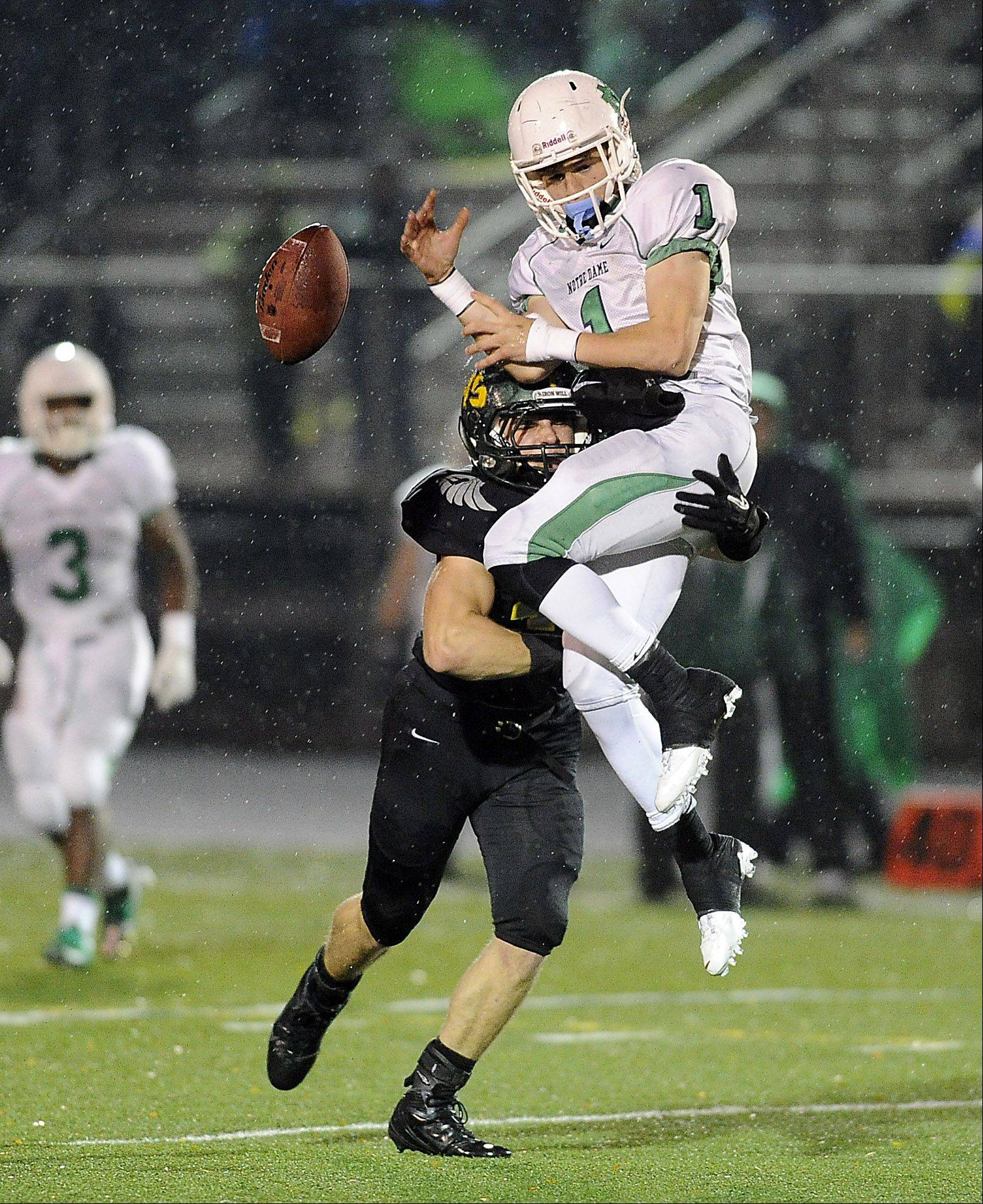 Fremd's Stephen Walsh breaks up a pass play against Notre Dame's Pat Cravens in the first half.