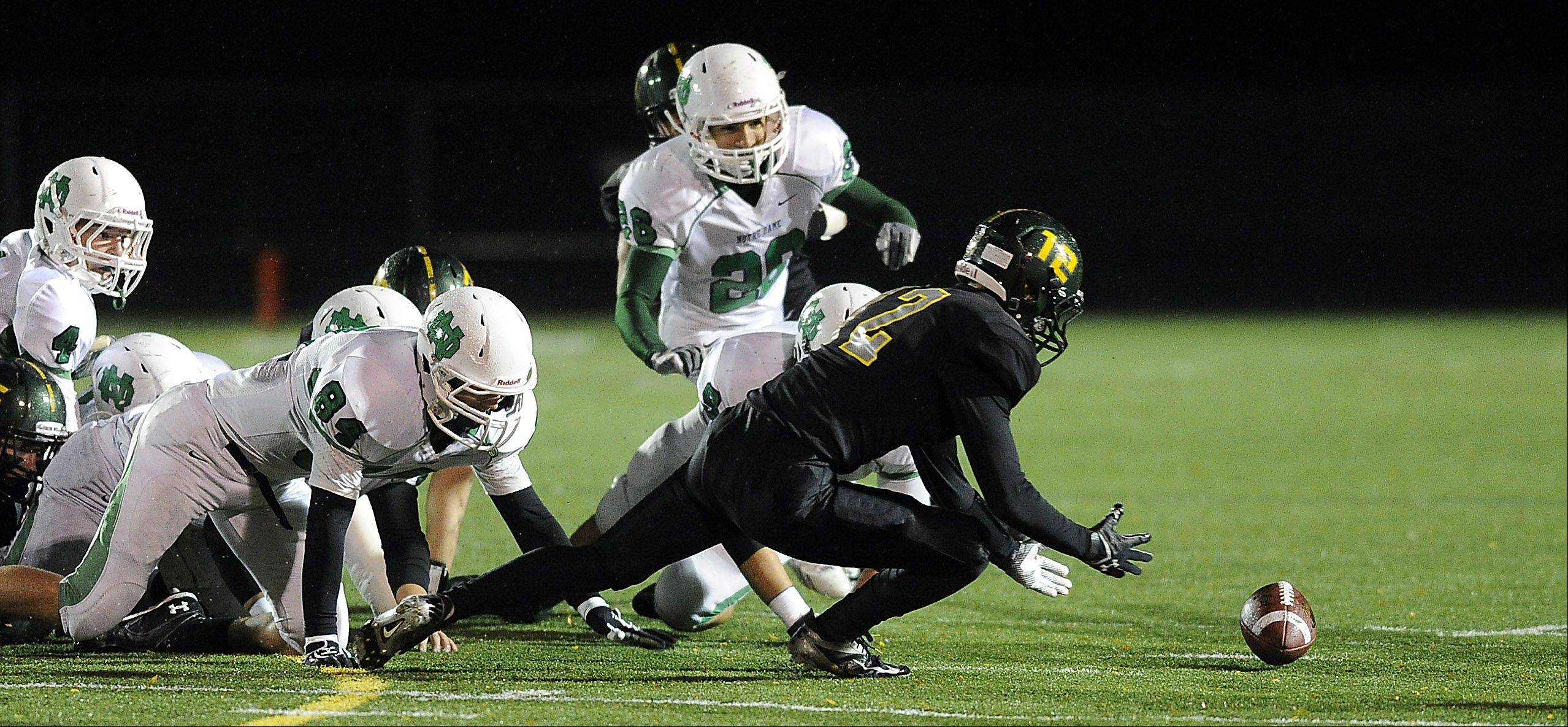 Fremd's Max Schroll recovers a fumble on a punt against Notre Dame in the first half.
