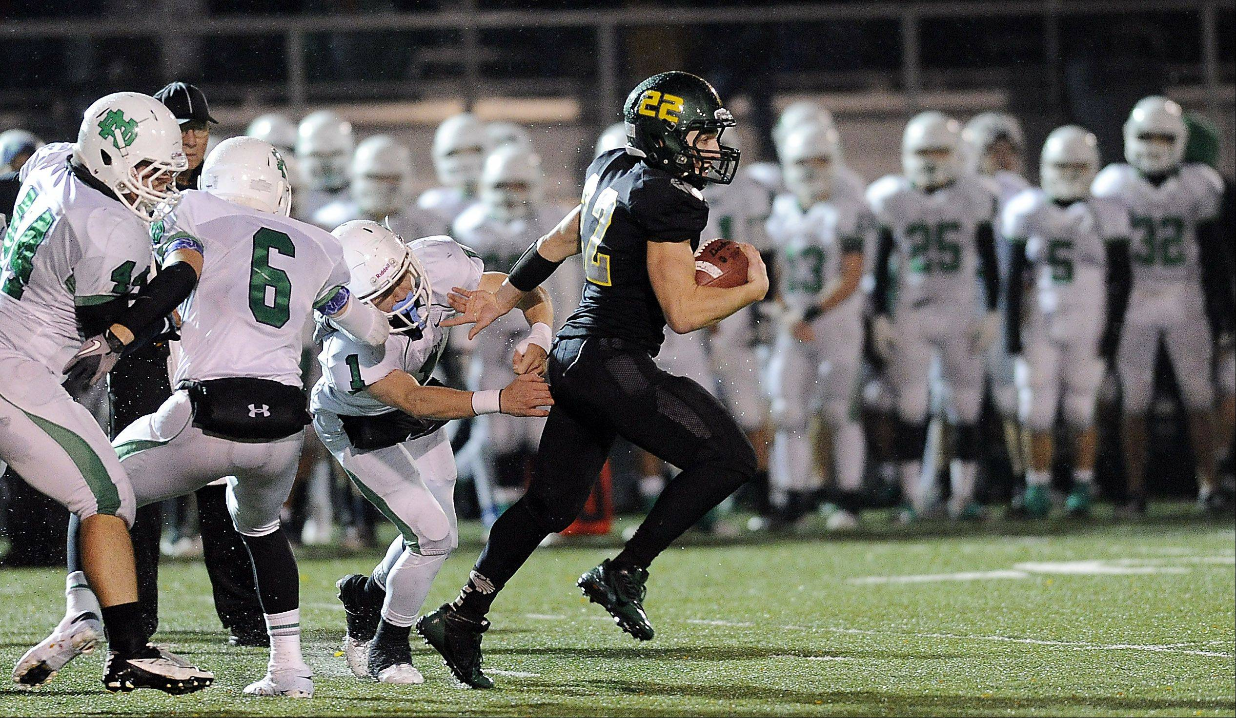Fremd's Garrett Groot scrambles for a 44-yard run in the second quarter.