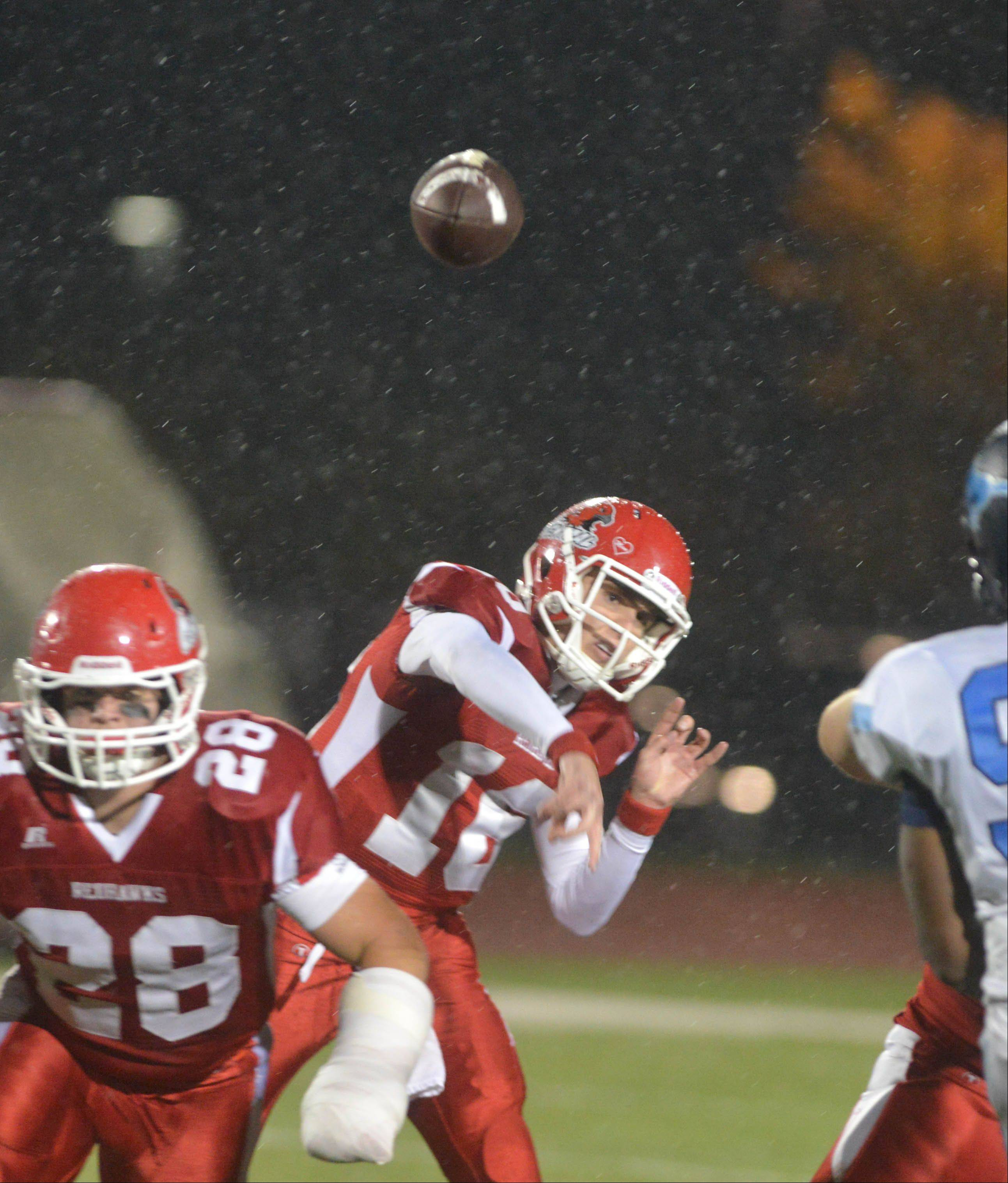 Jake Kolbe of Naperville Central throws a pass against Downers Grove South Friday night in Naperville.